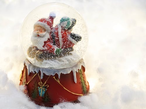 Close-up Photography Of Santa Claus Snow Globe