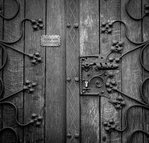 Wooden Door in Grayscale Photography