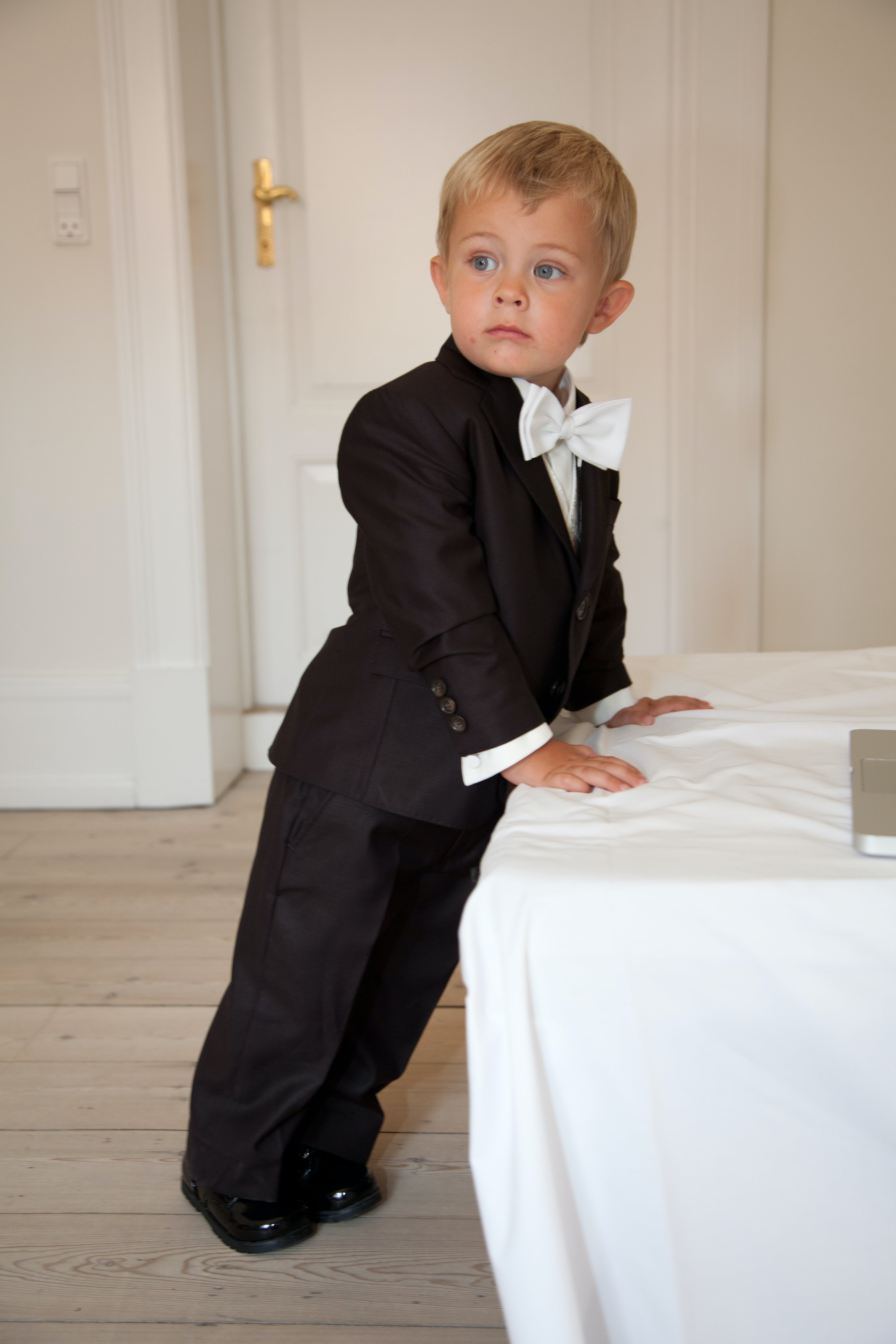 Boy Leaning on White Cloth