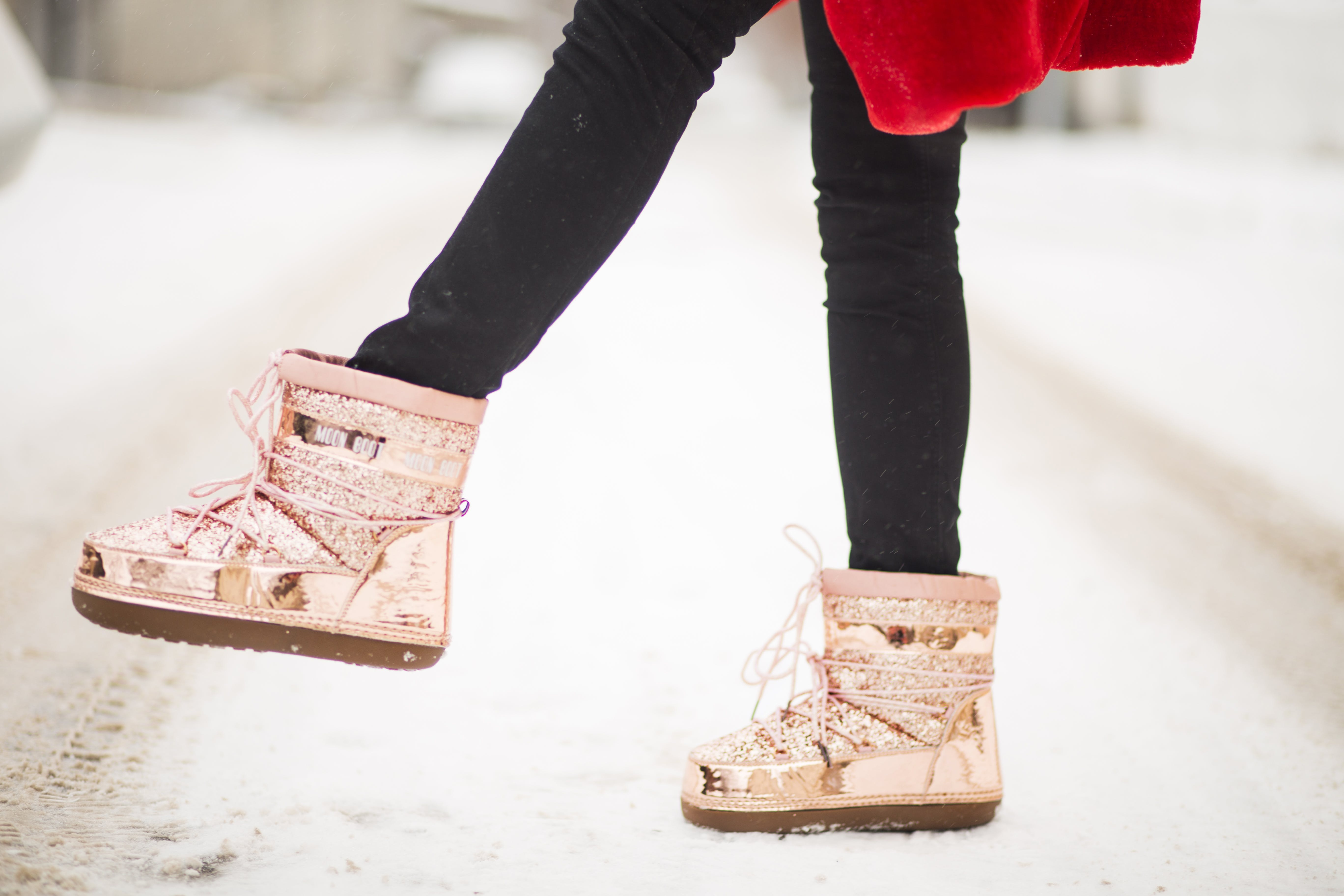 Person Wearing Gold Patent Leather Snow Boots
