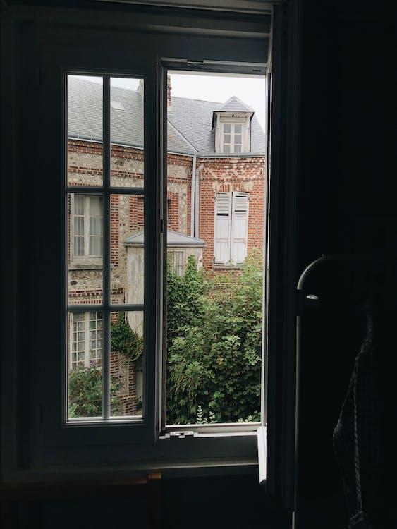 Open Window Across Red Building