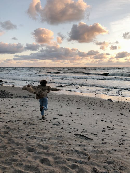 Person Running On Shore