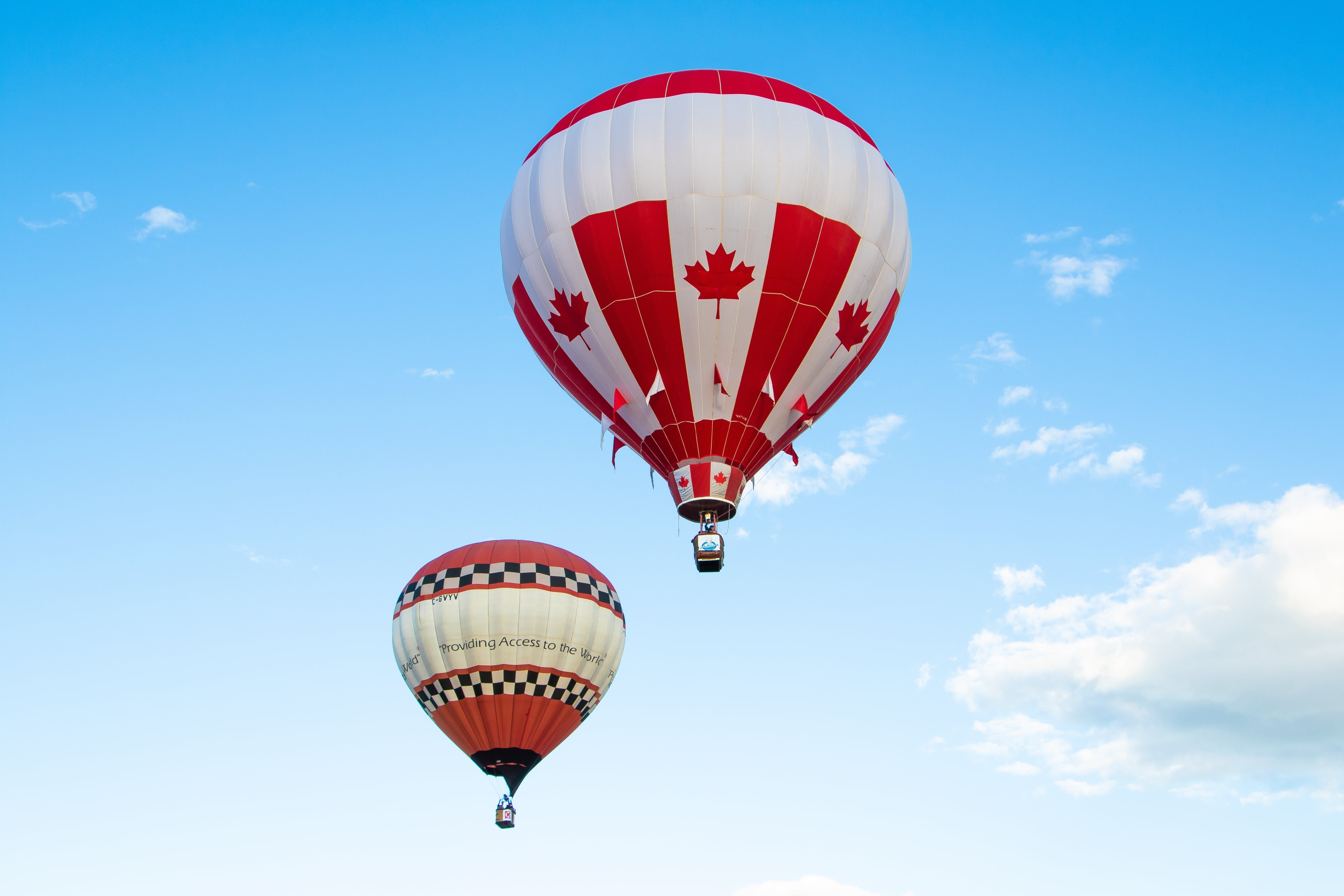 Two White And Red Hot Air Balloons