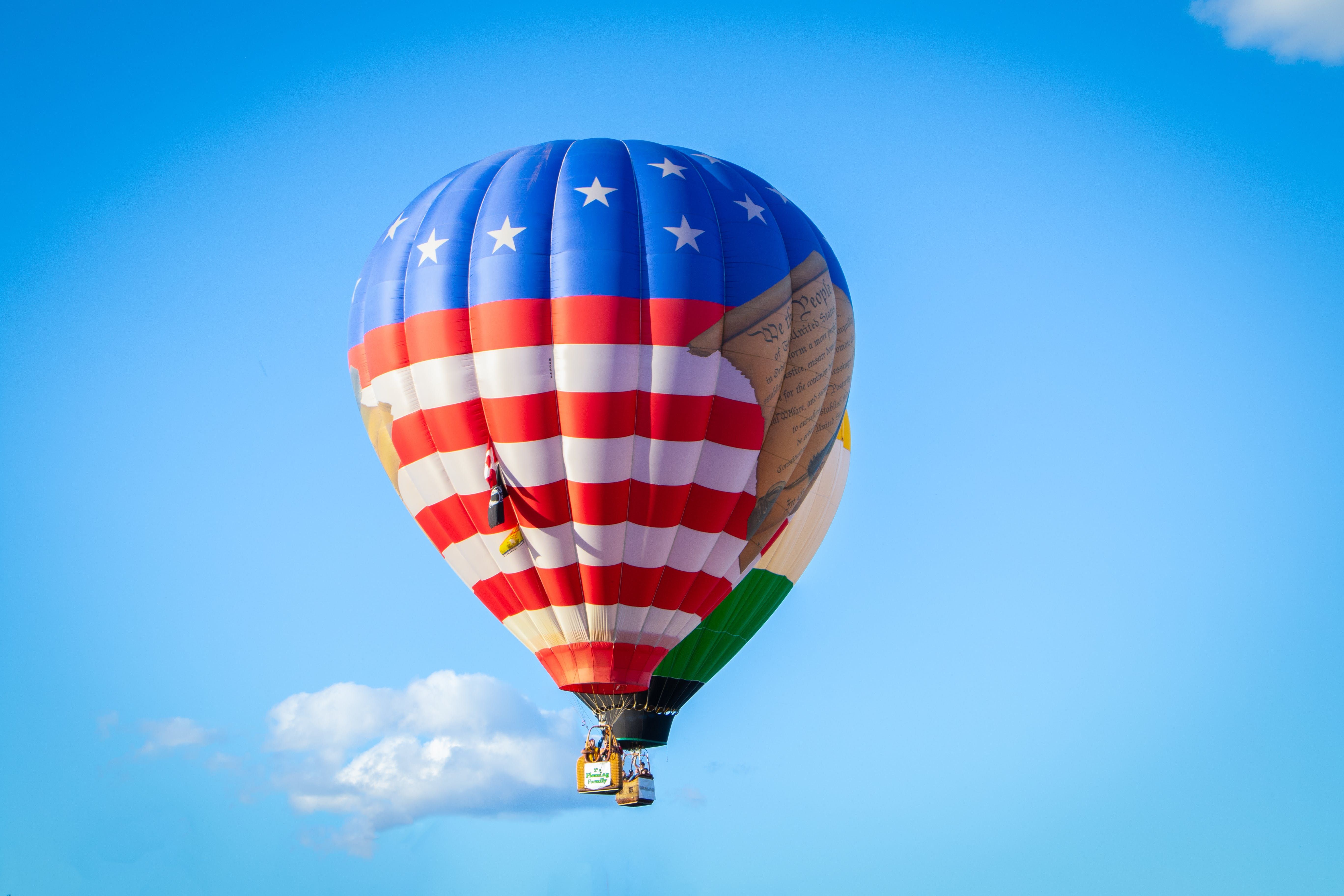 White, Red, and Blue Hot Air Balloon Flying