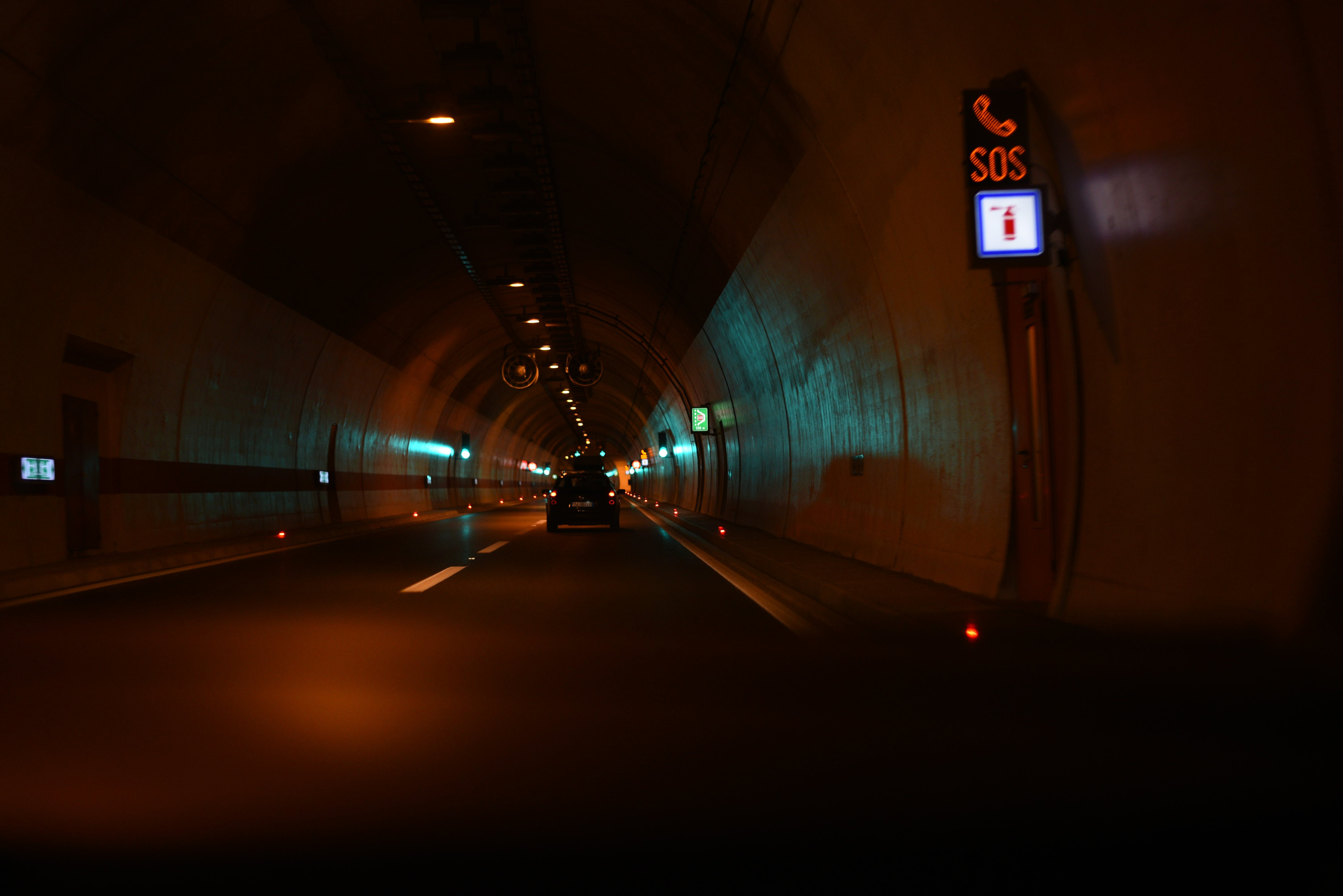Vehicles on Tunnel Road at Nighttime