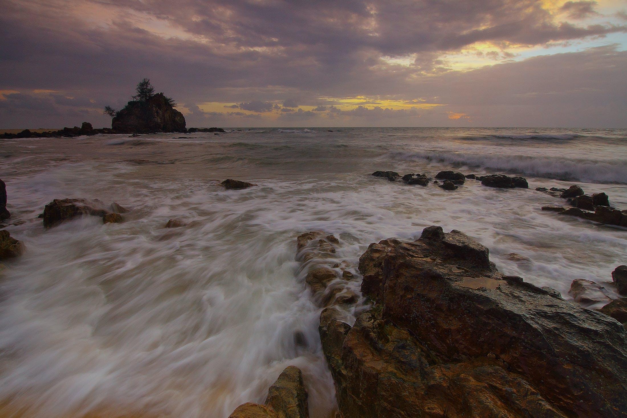 Flowing Water to the Ocean Under Grey Sky