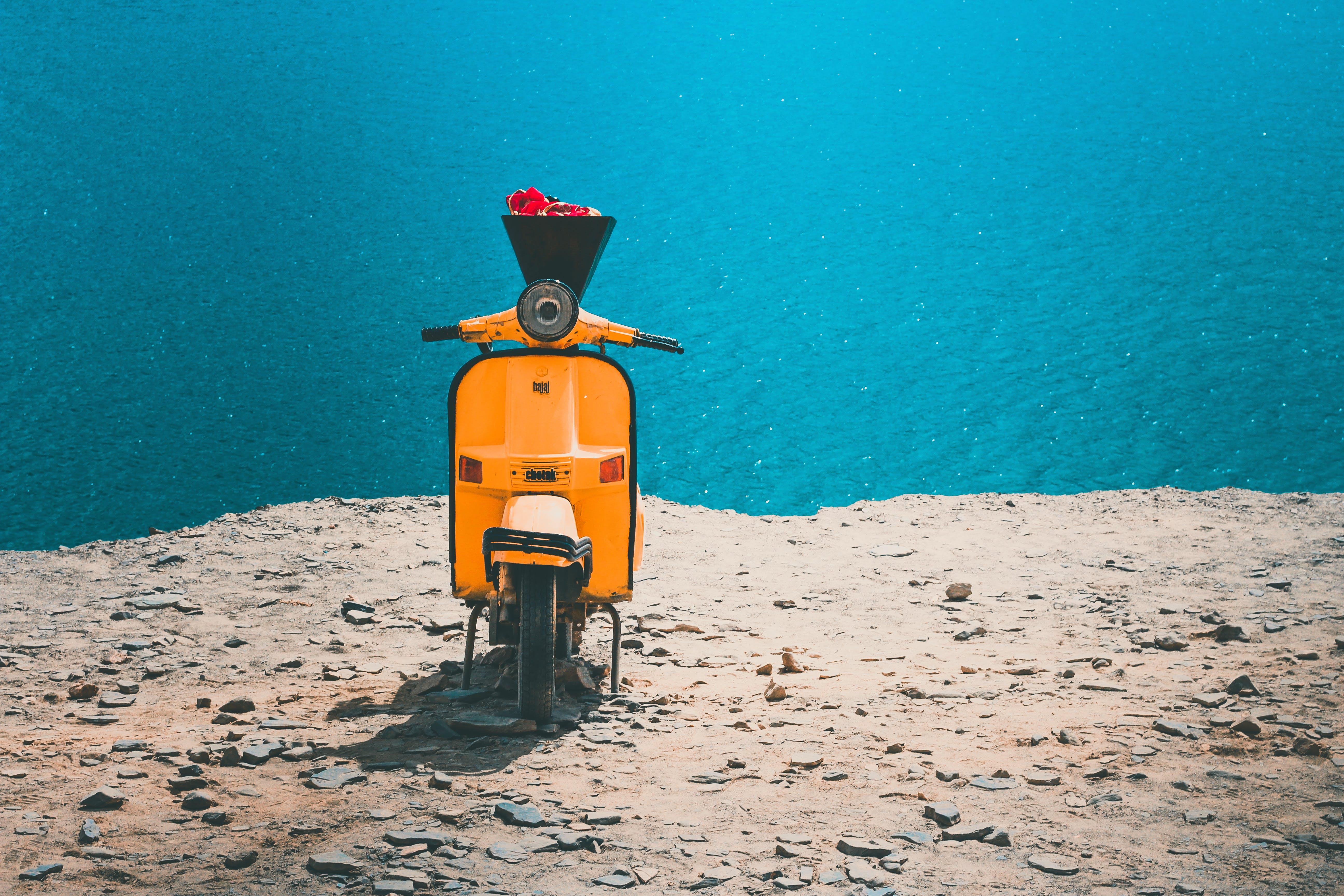 Orange and Black Motorcycle on Brown Sand
