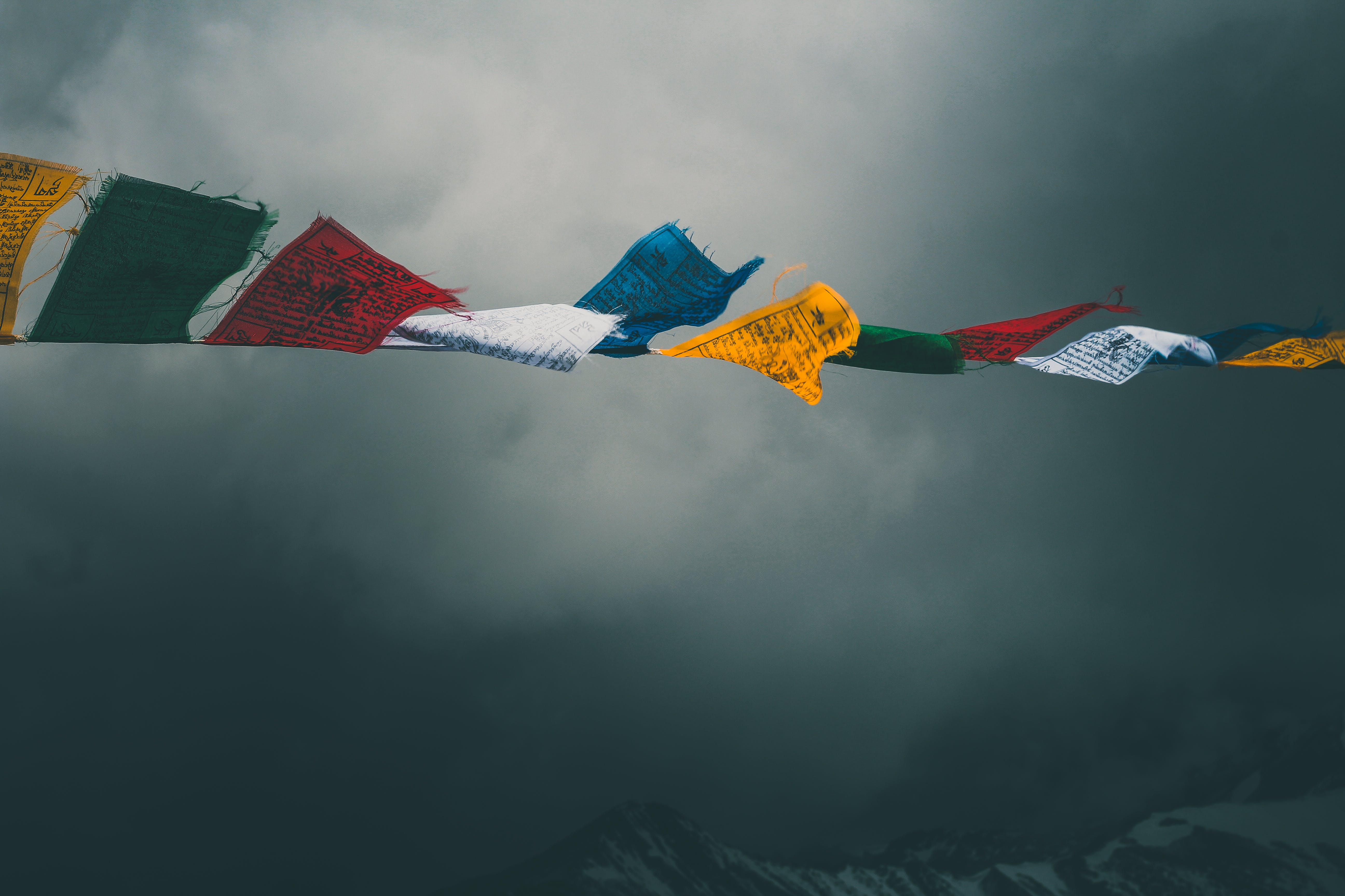 Assorted-color Flags Under Gray Clouds