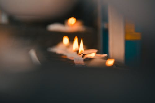 Selective Focus Photography of Lighted Tealights