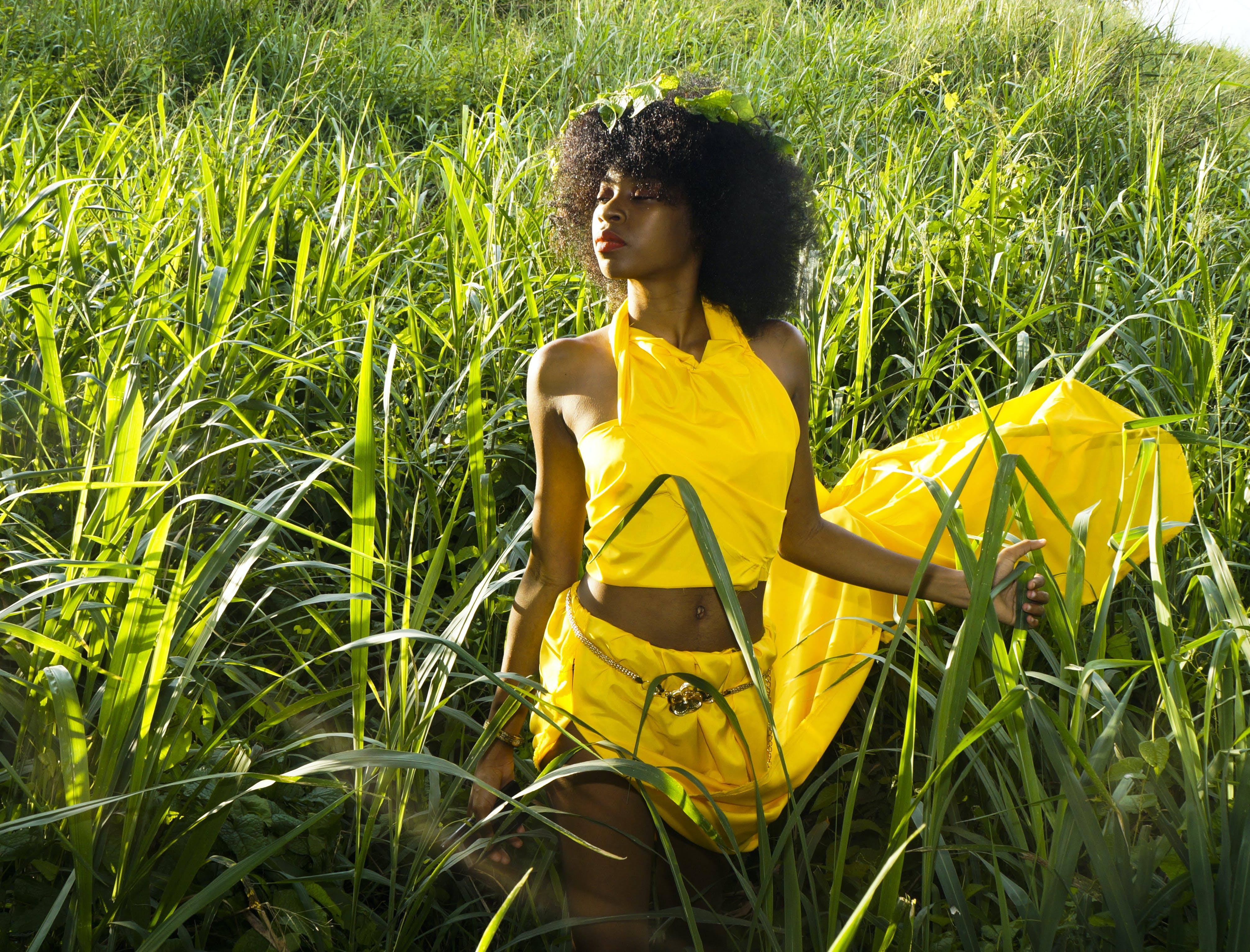 Woman In Yellow Dress Standing On Tall Grass