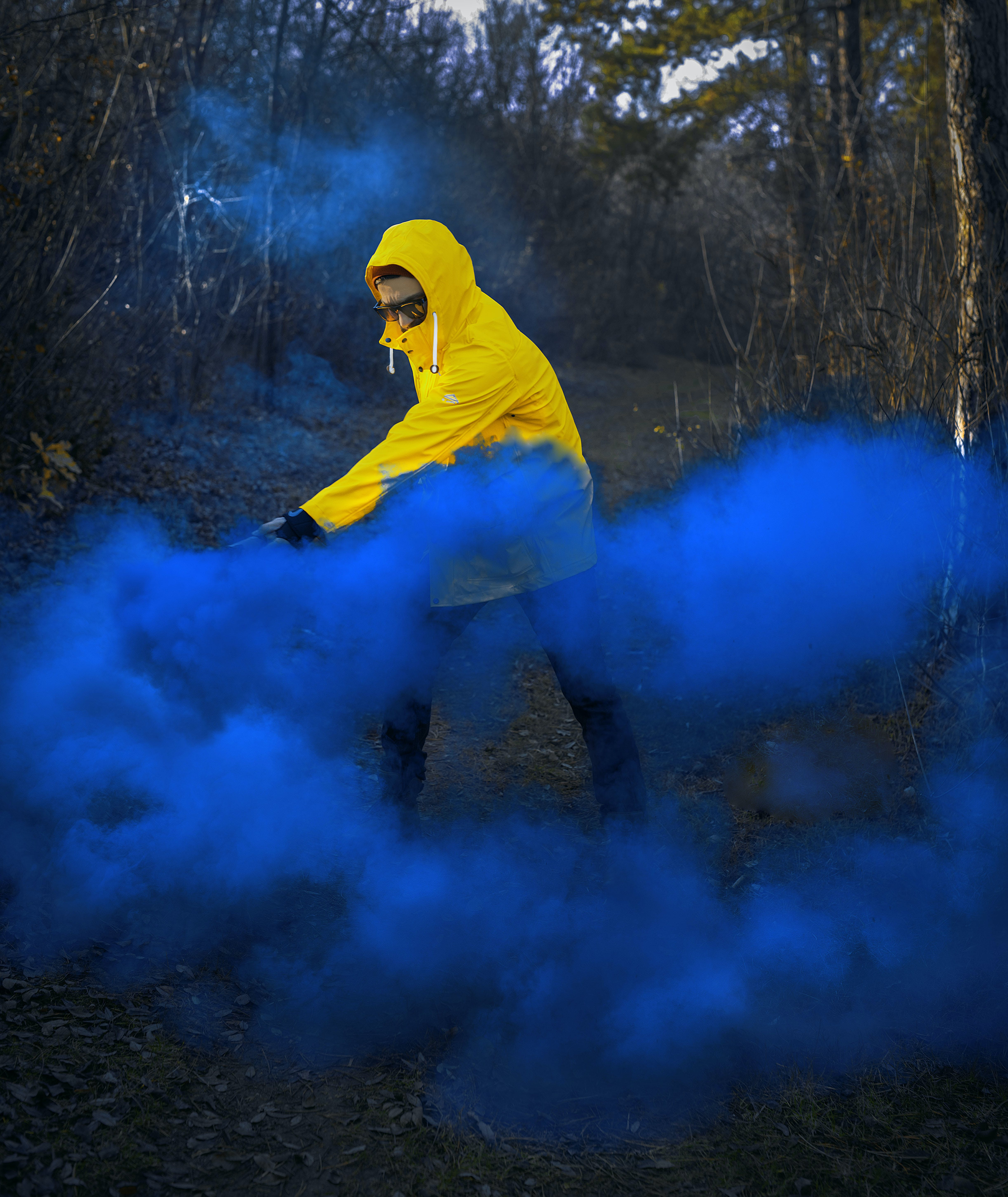Man Wearing Hoodie Near Blue Smoke