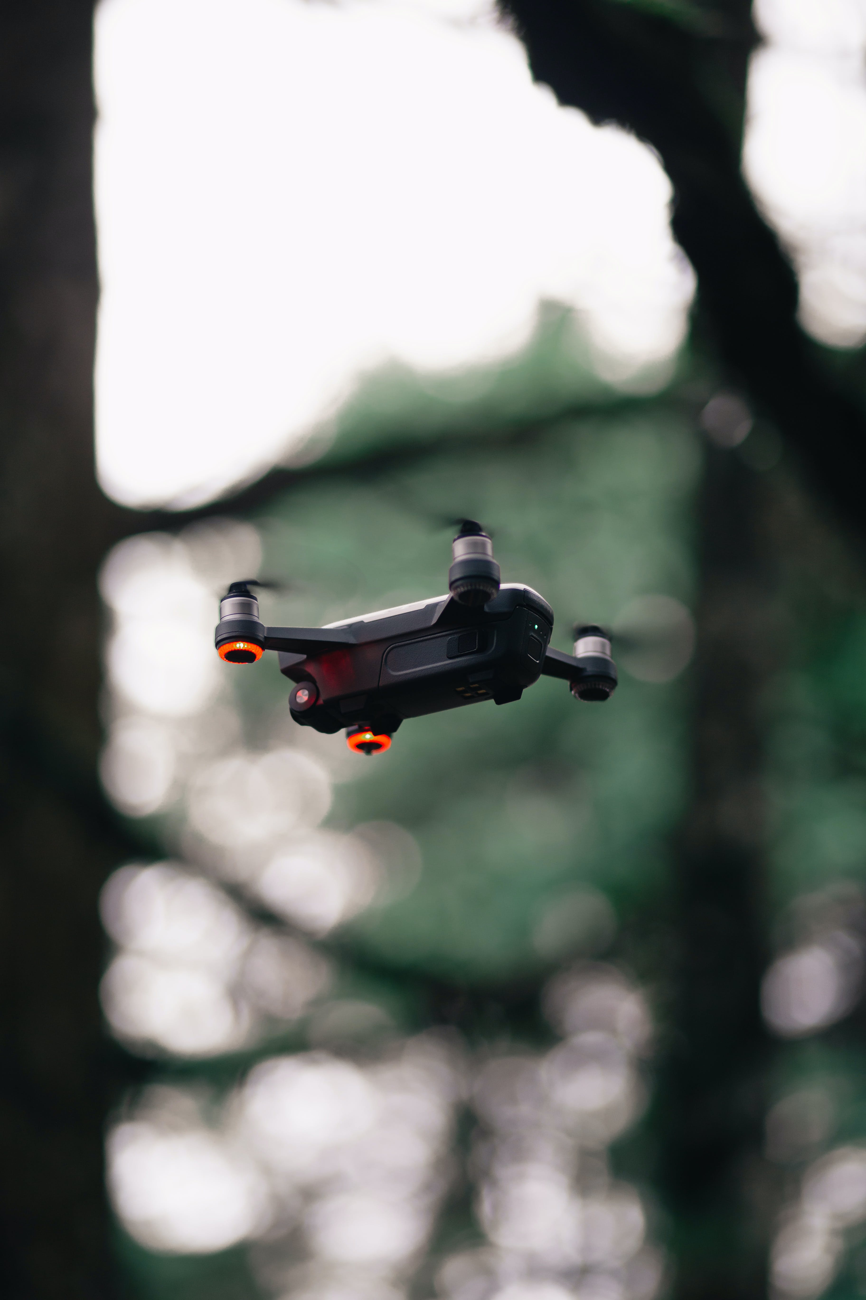 Black Quadcopter Drone Hovering Mid-air