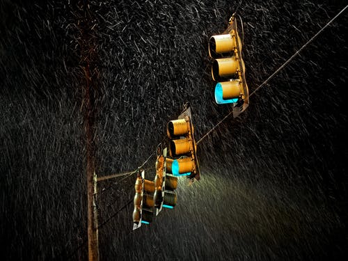 Four Traffic Lights Under the Rain