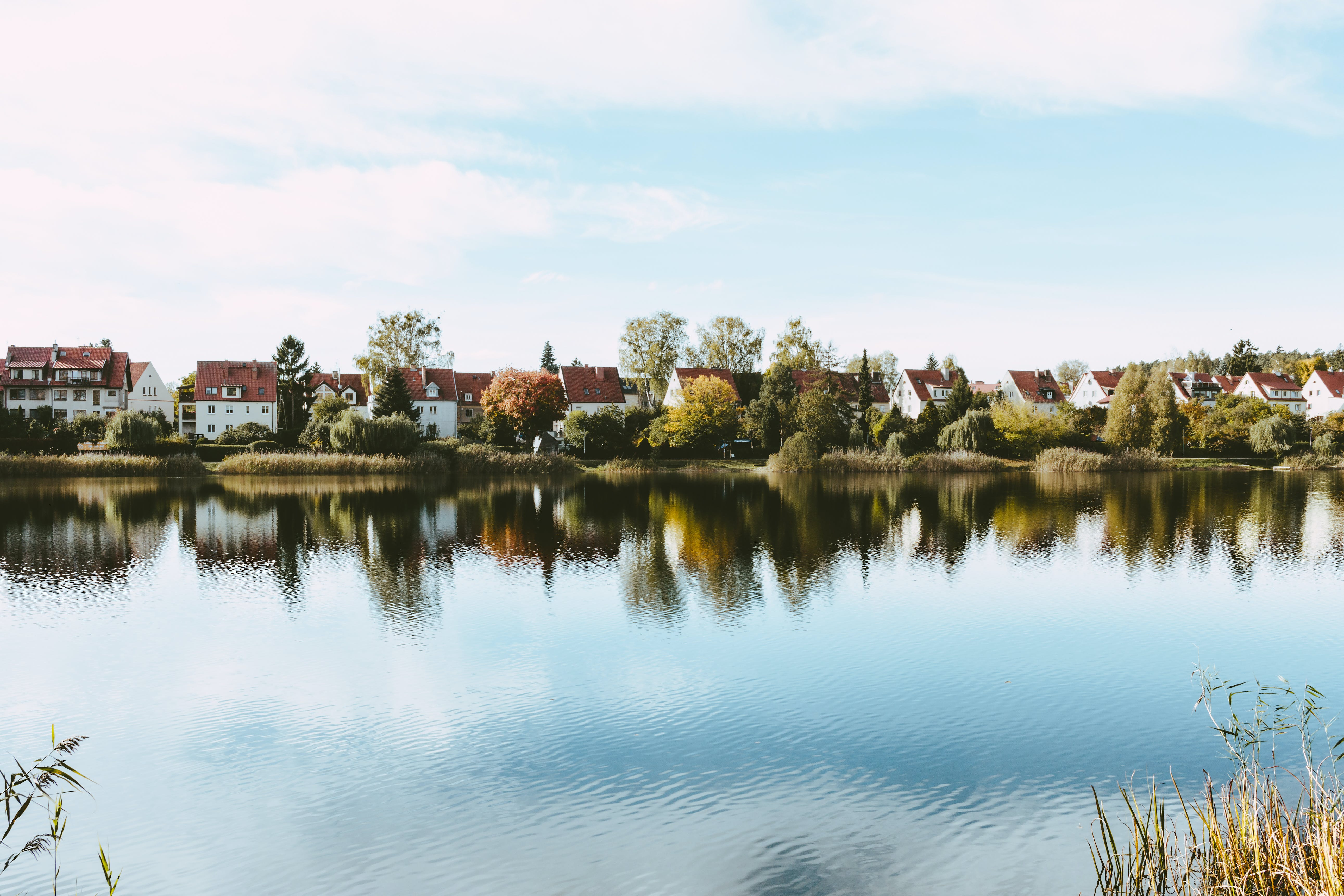Village Houses Near Rippling Body of Water