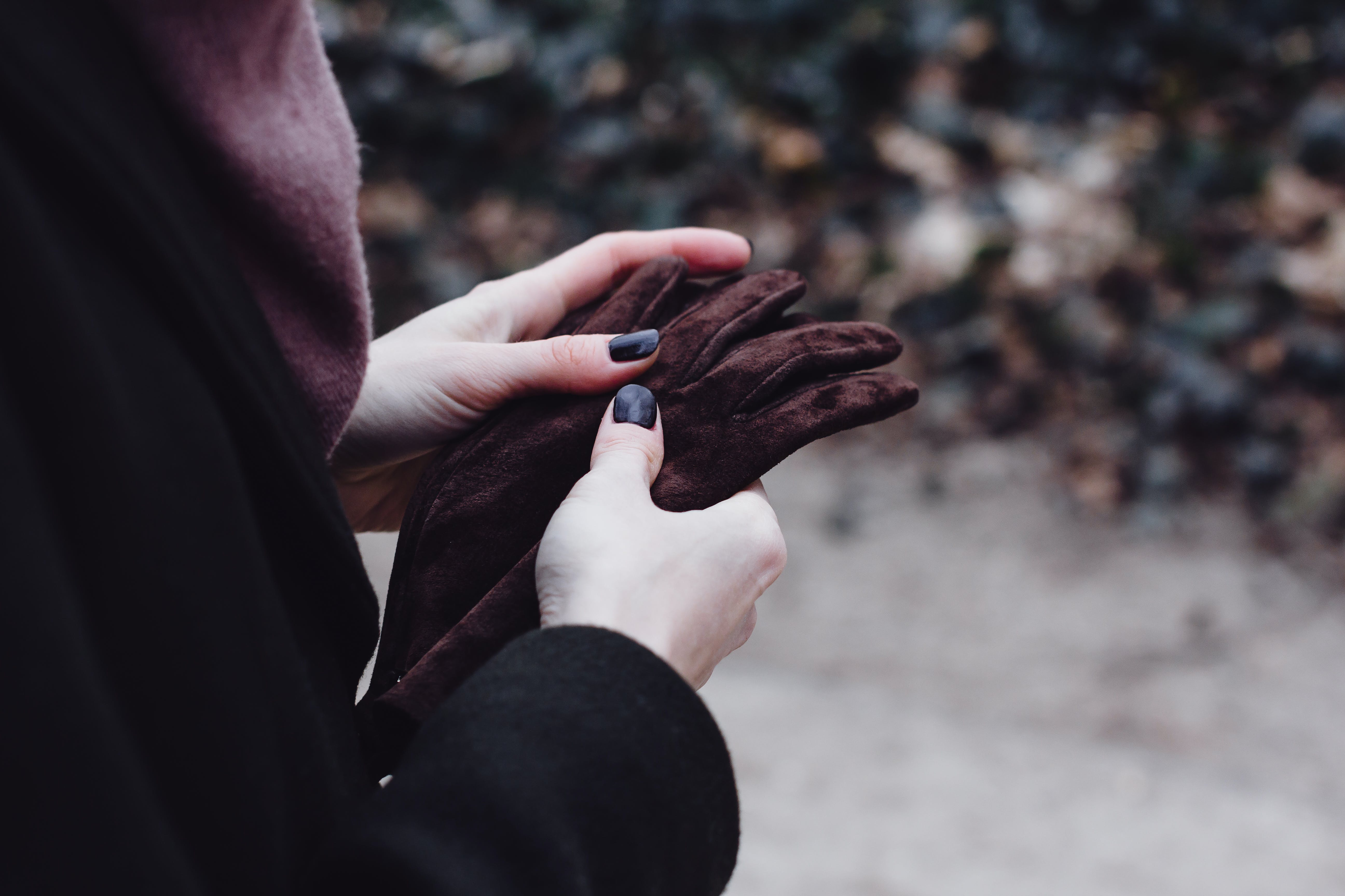 Person Holding Gloves