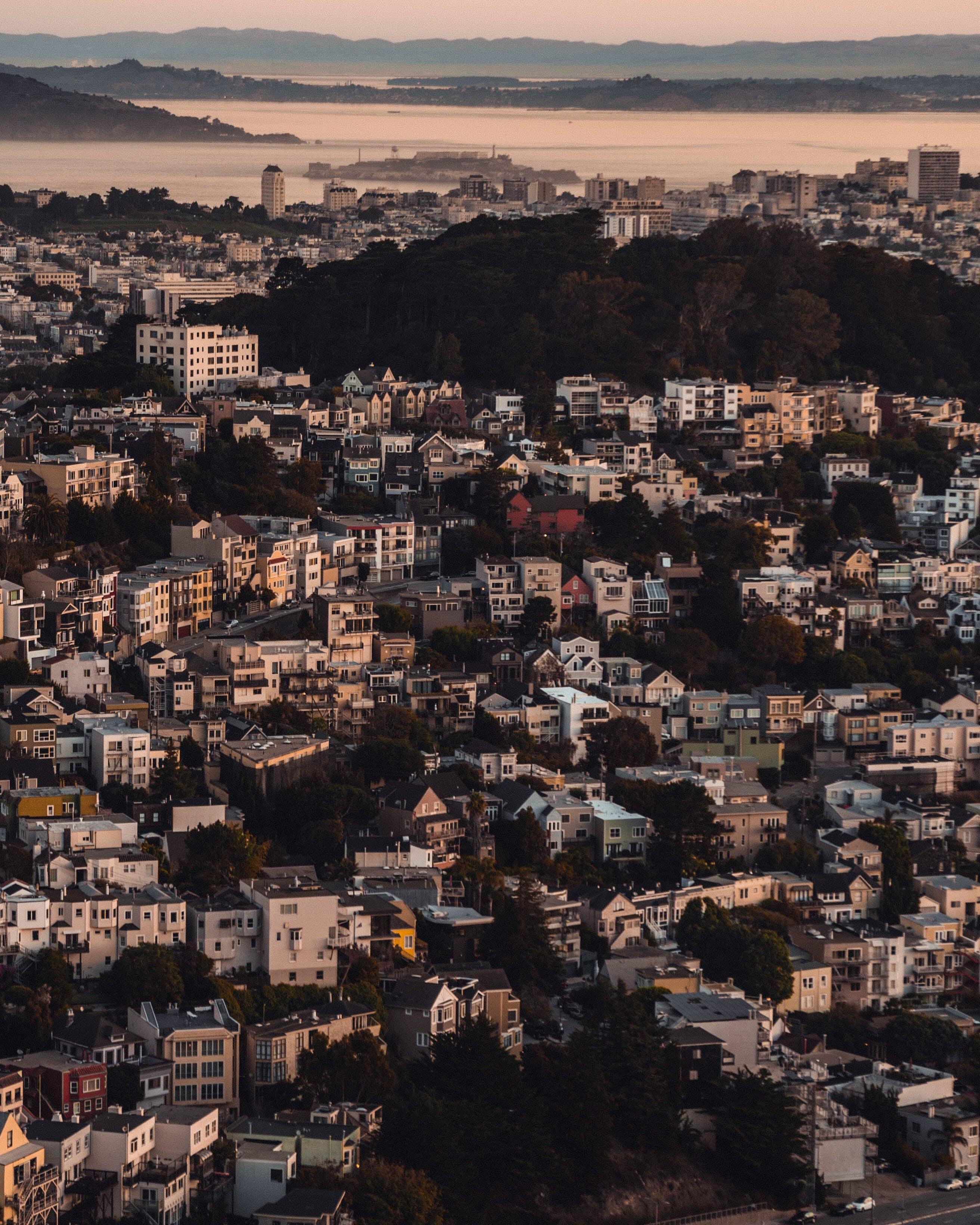Kostenloses Stock Foto zu architektur, gebäude, goldene stunde, häuser