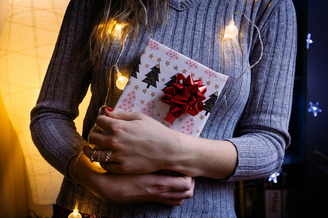 Woman Holding White Gift Box