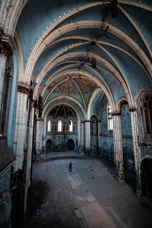 Man Standing Inside Abandoned Building