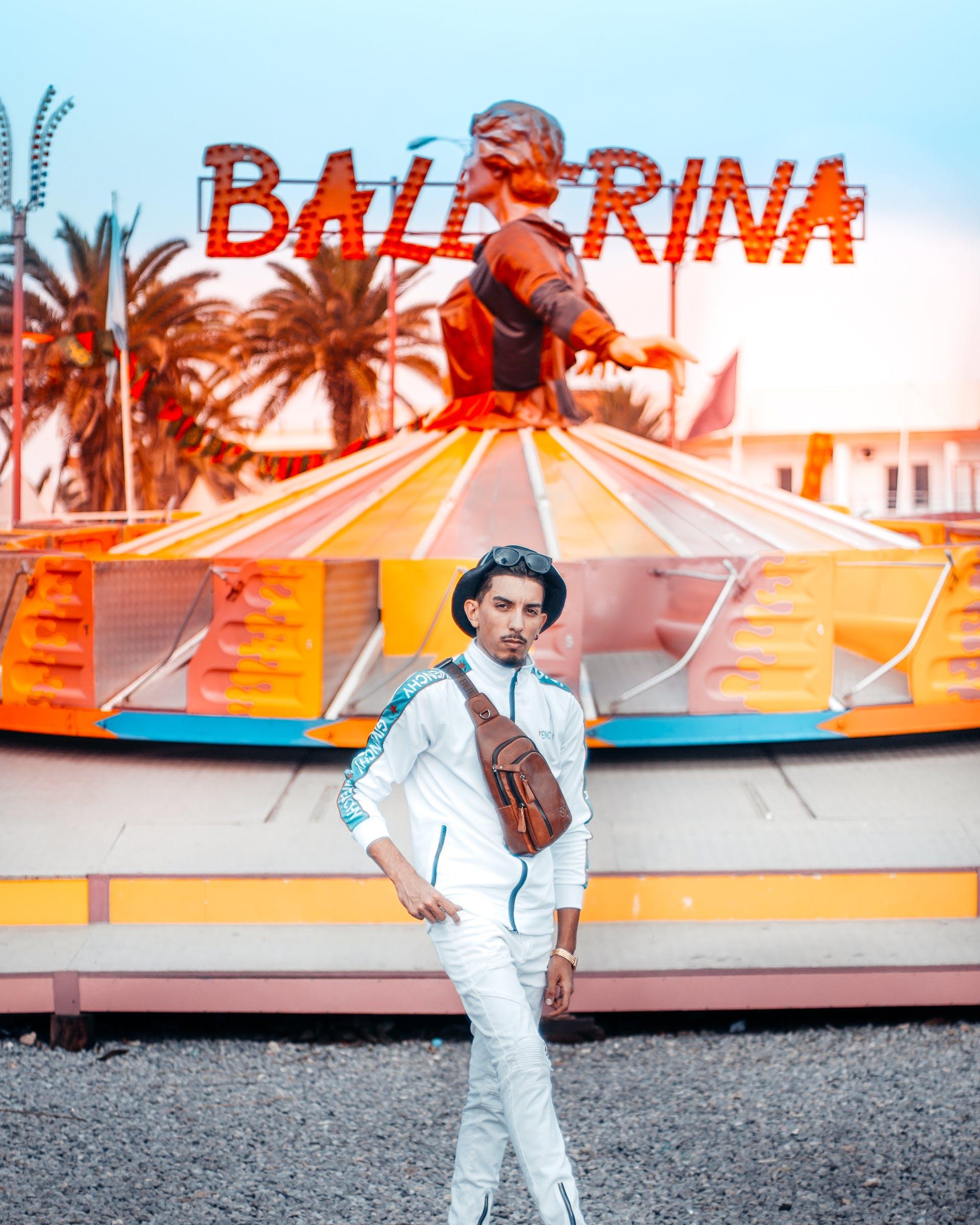 Man Standing With Balerina Statue