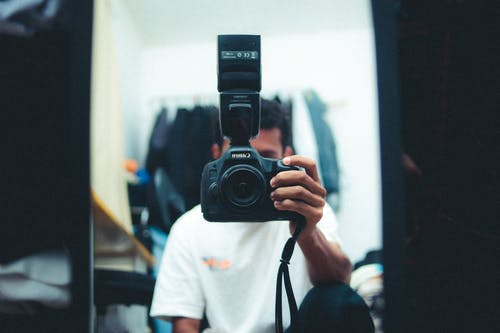 Man Holding Black Camera