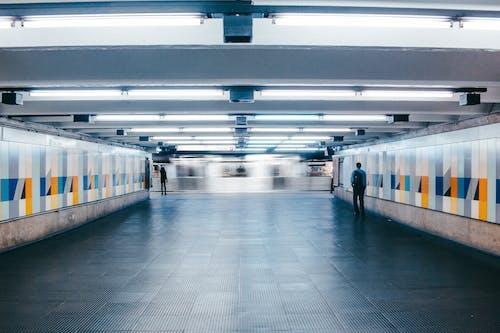 Man Walking on Subway Lobby