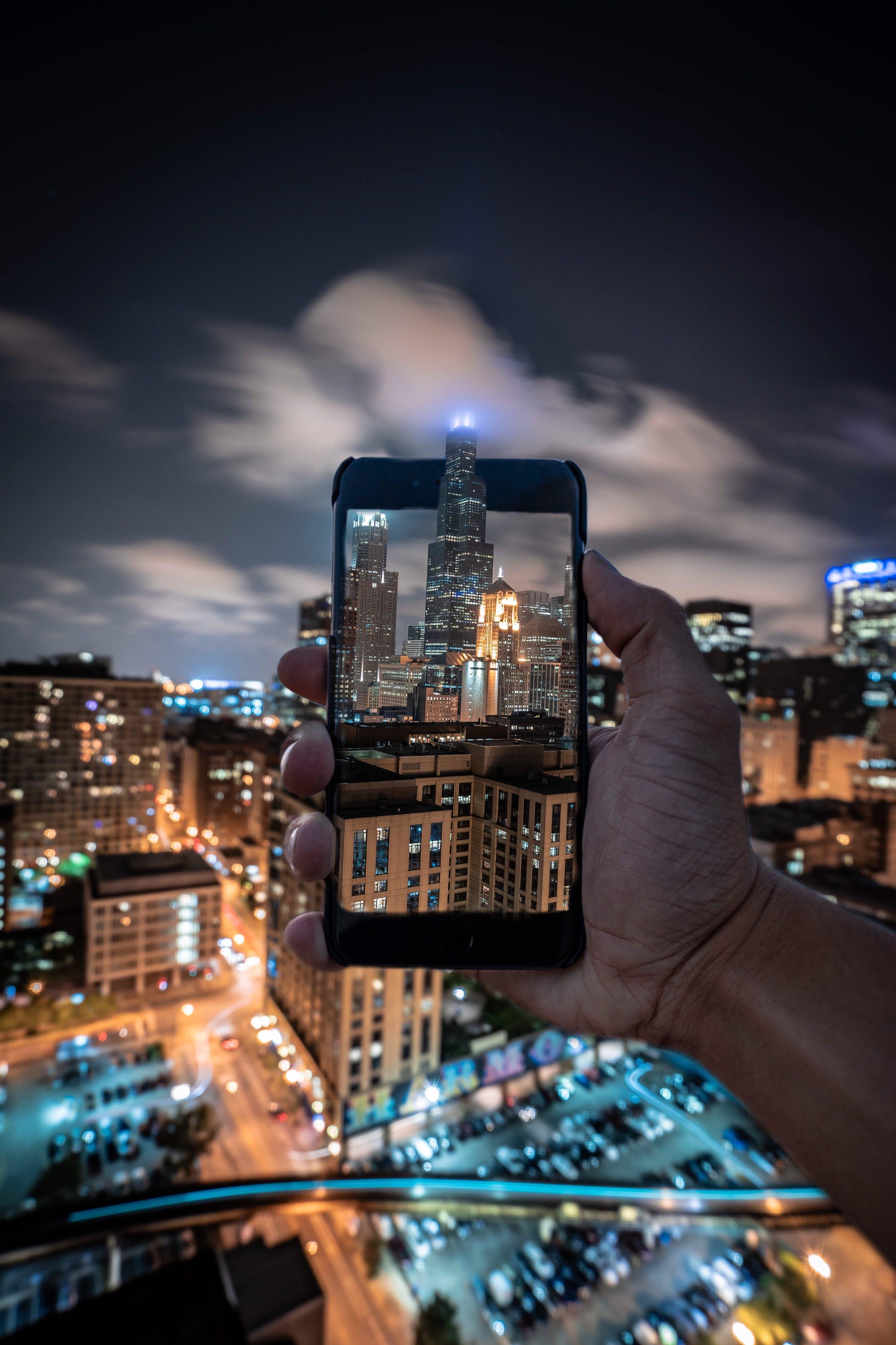 Person Taking Photo of Skyscraper