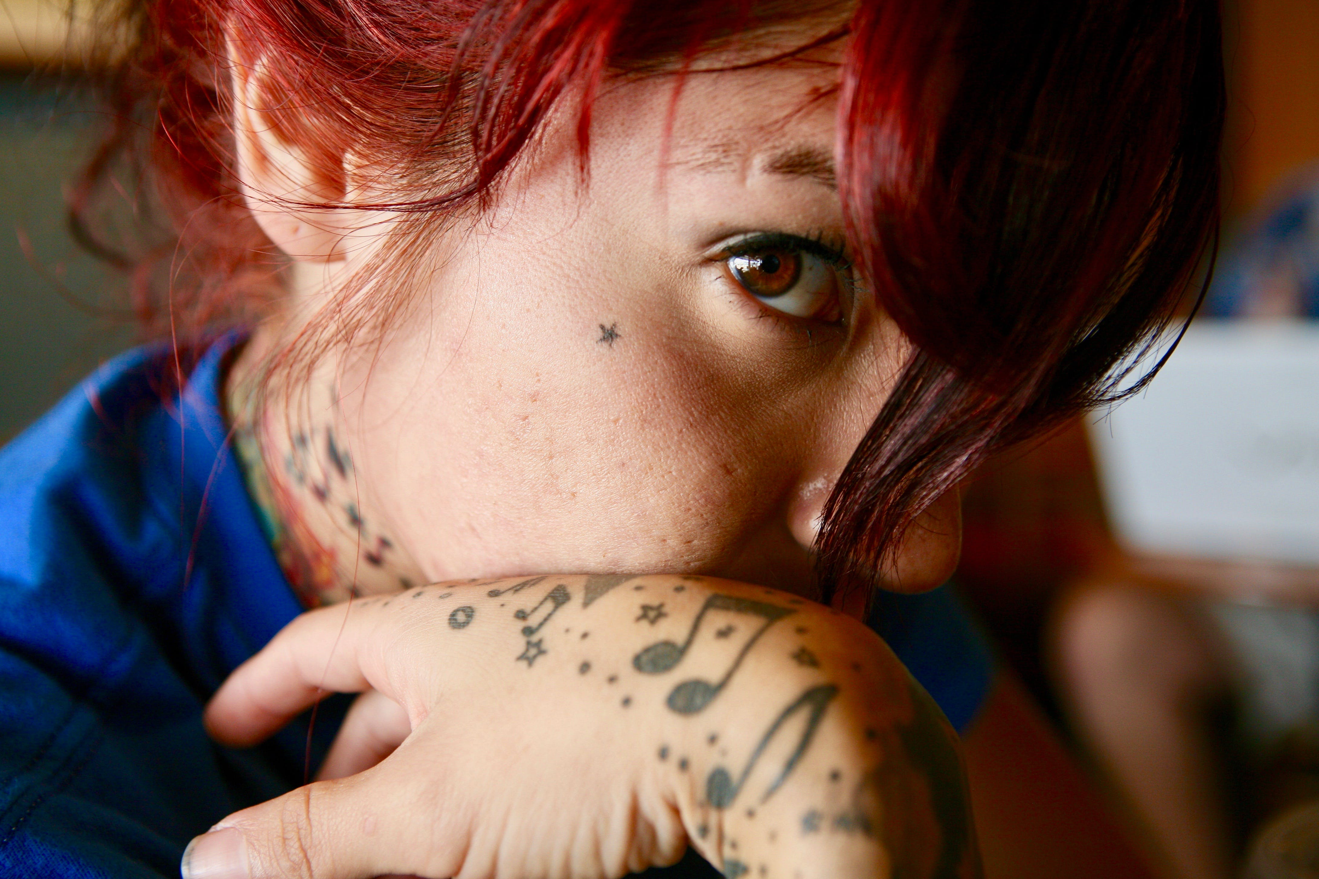 Close-up Photo of Woman with Tattoos