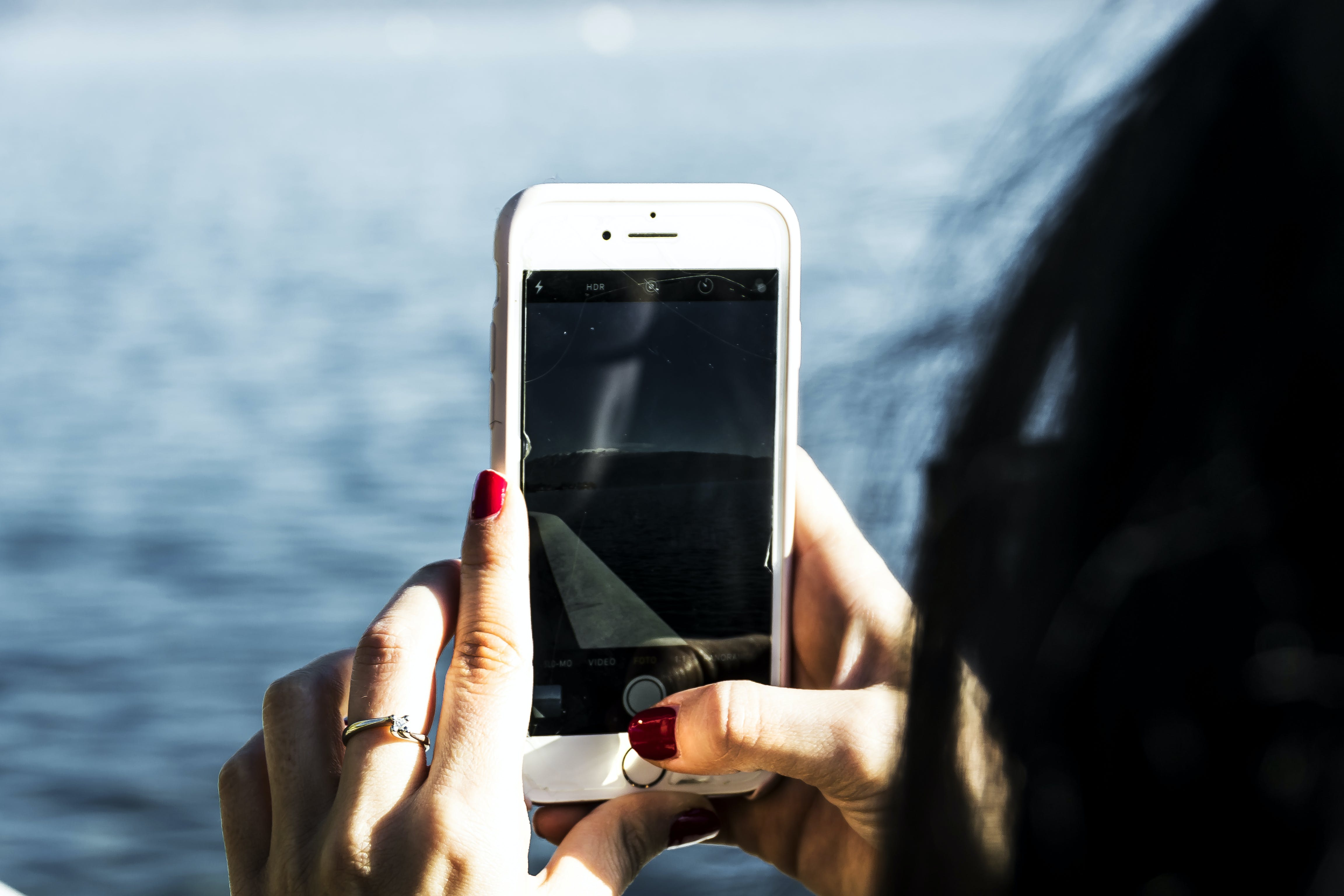 Person Taking Photo Of Body Of Water Using Iphone