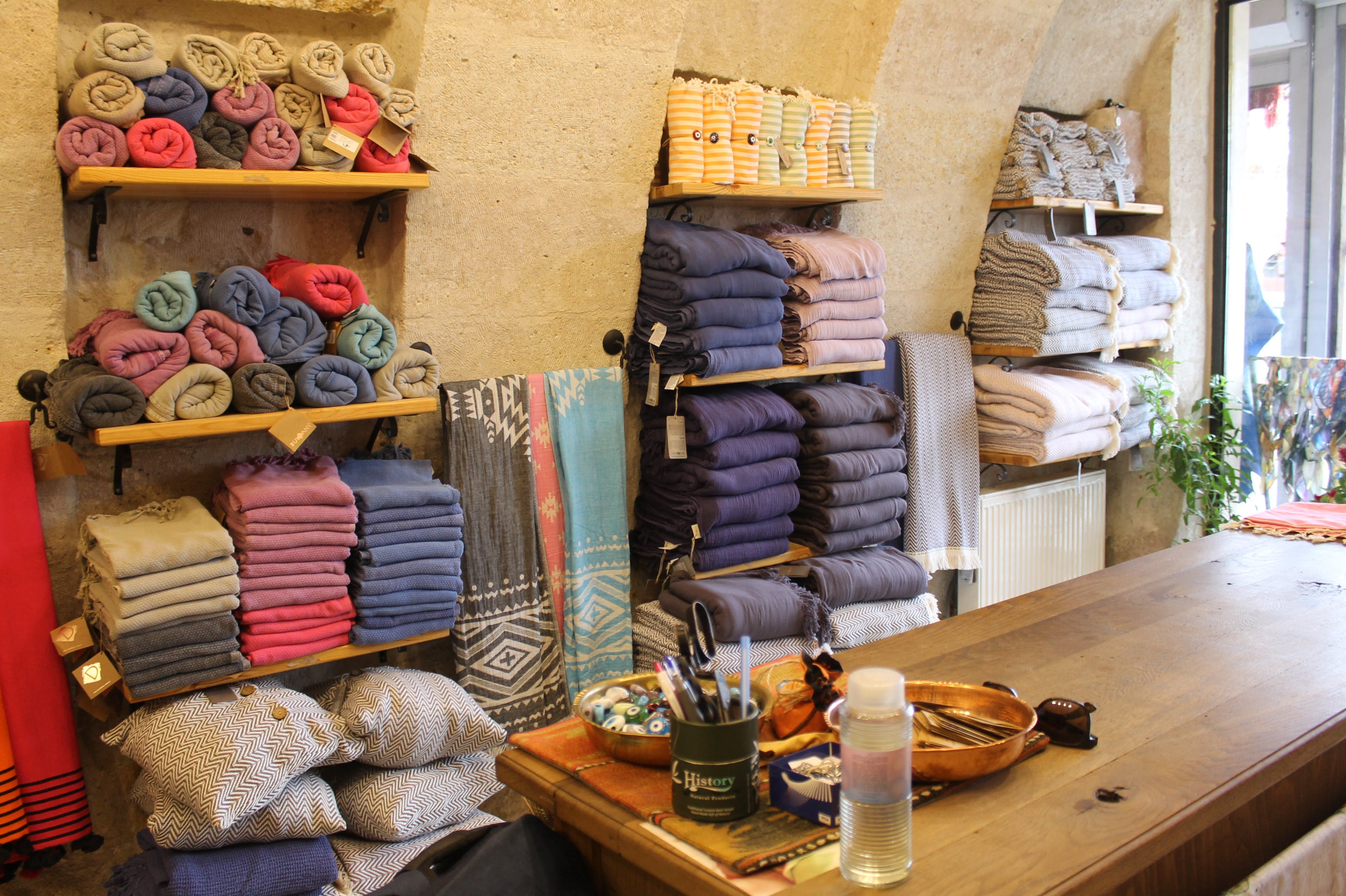 Assorted-color Towels on Wooden Rack