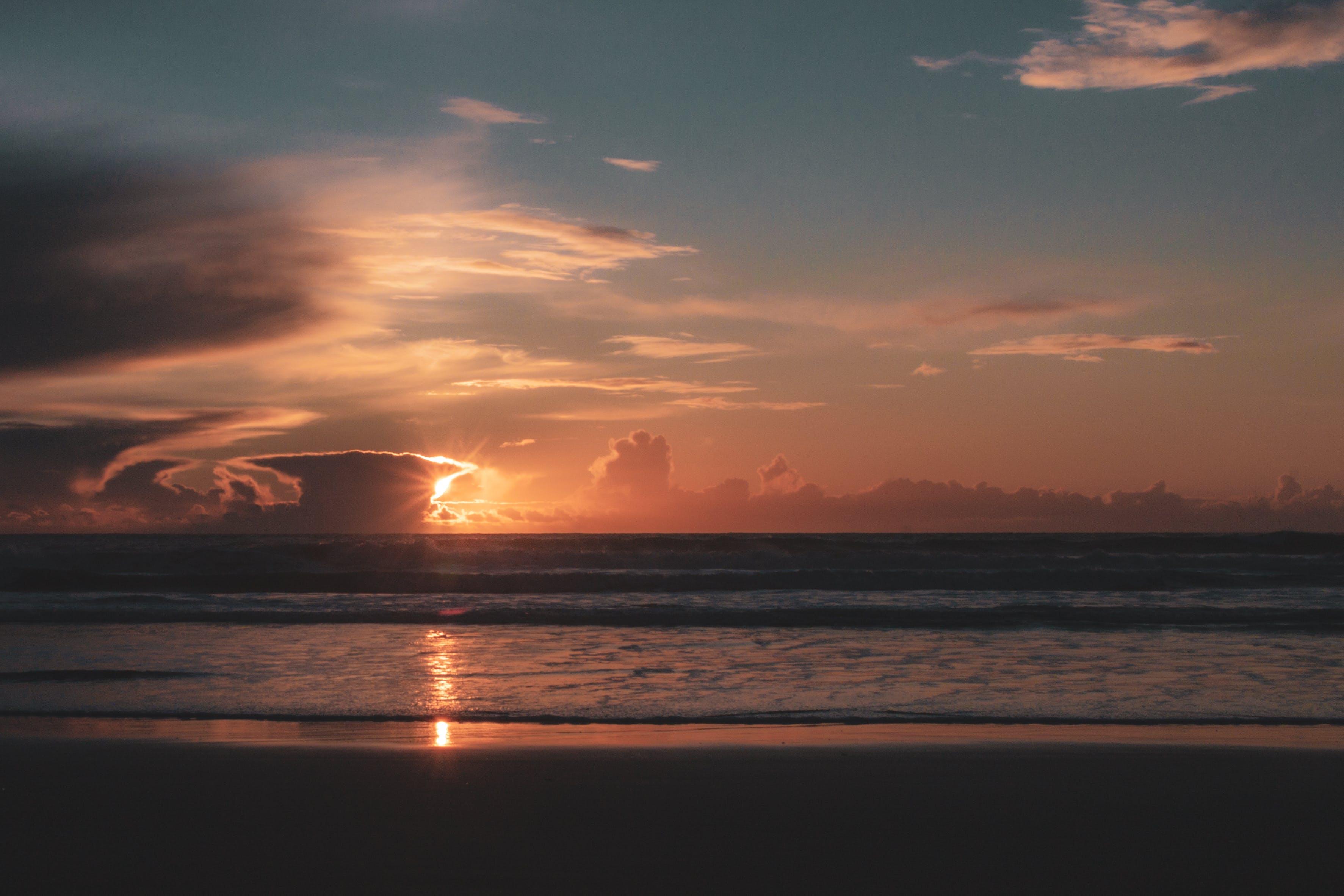 Photo of Beach During Sunset