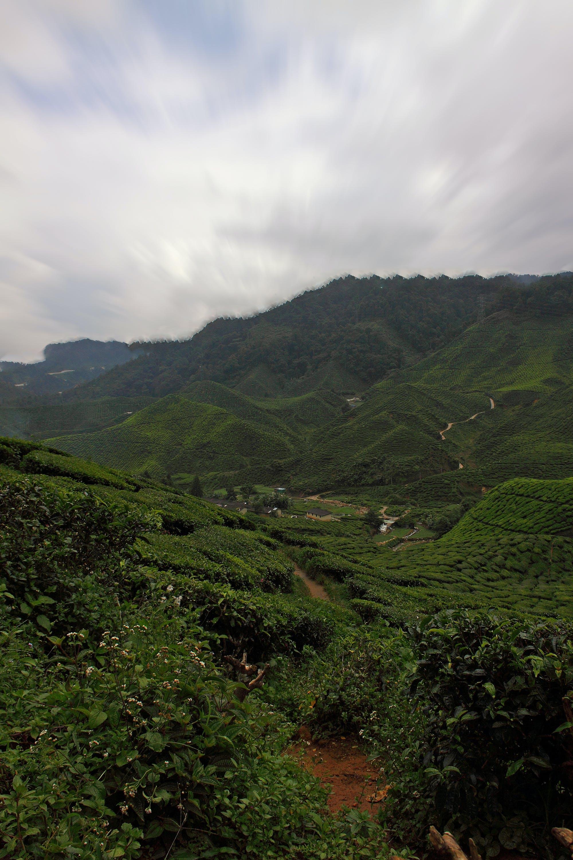 Green Mountain Under White Cloudy Sky