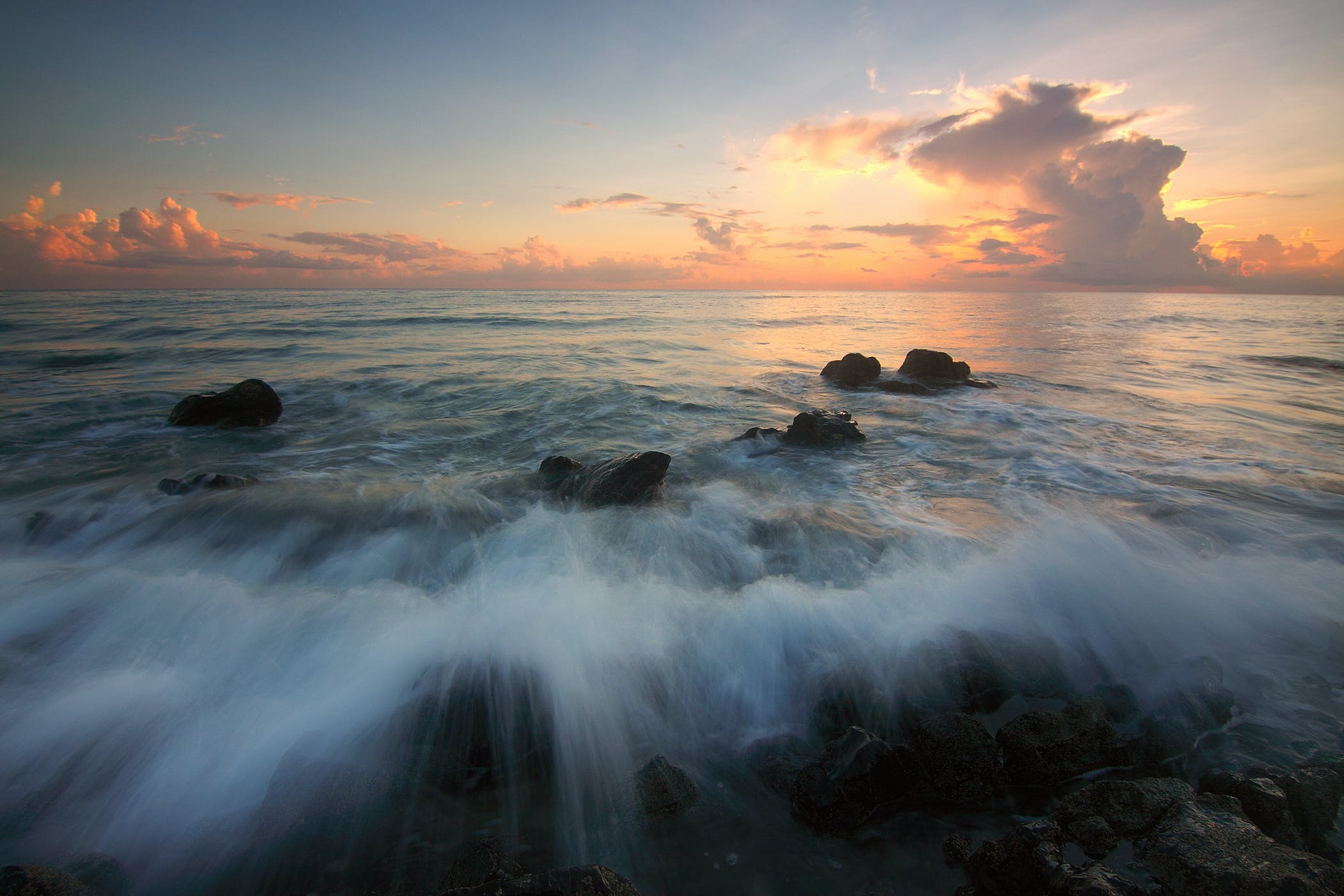 Time-lapsed Photography of Seashore during Golden Hour