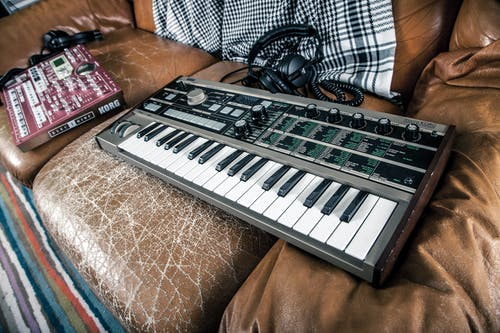 Gray Electronic Keyboard on Sofa