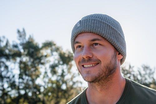Smiling Man Wearing Gray Knit Cap