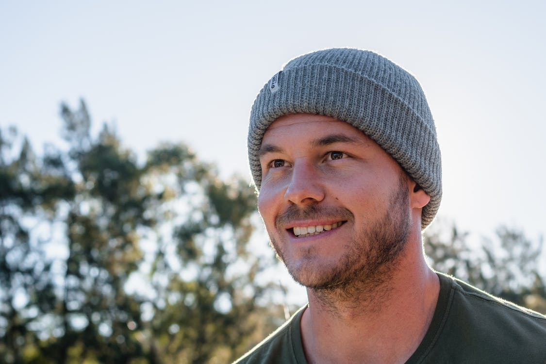 Smiling Man Wearing Gray Knit Cap