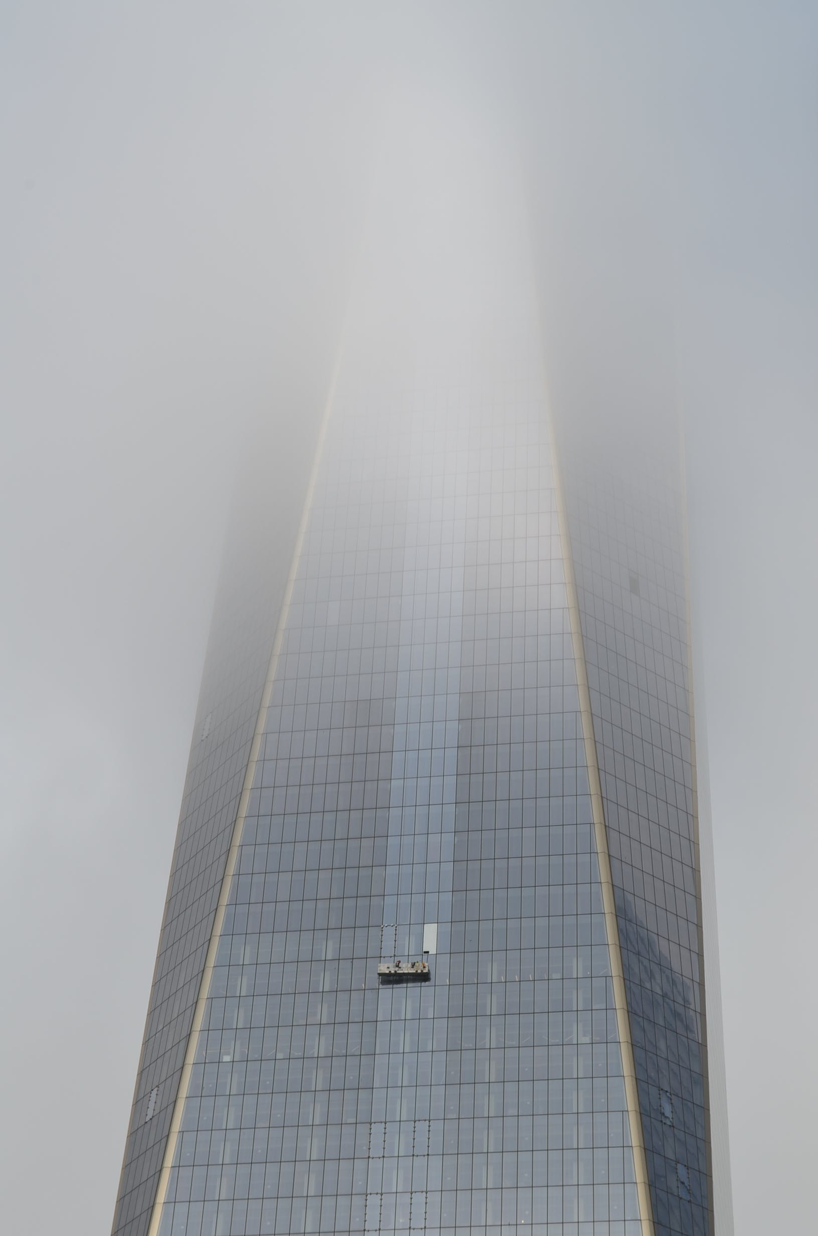 Glass Walled Building Covered by Fog
