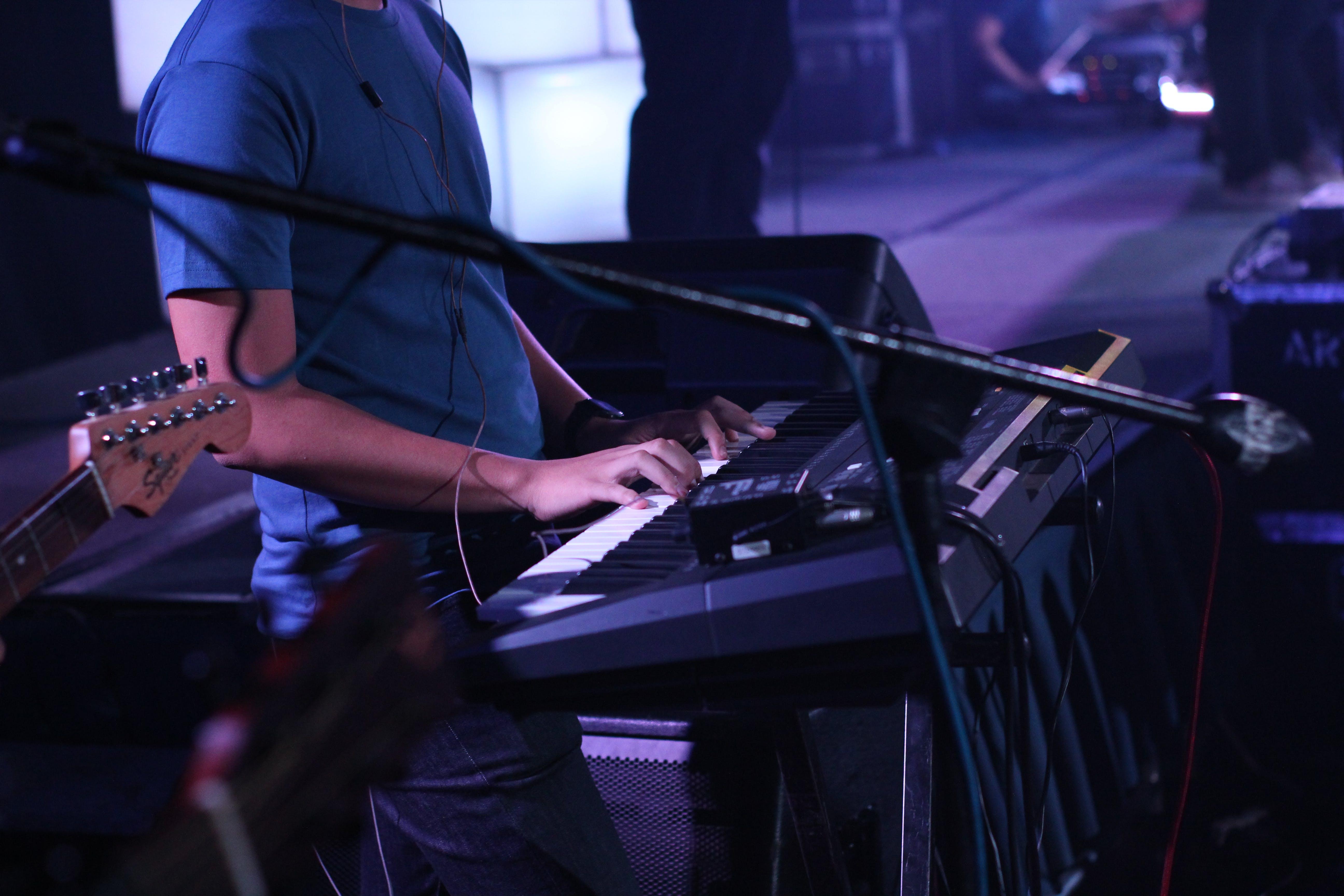 Man Standing While Playing Keyboard