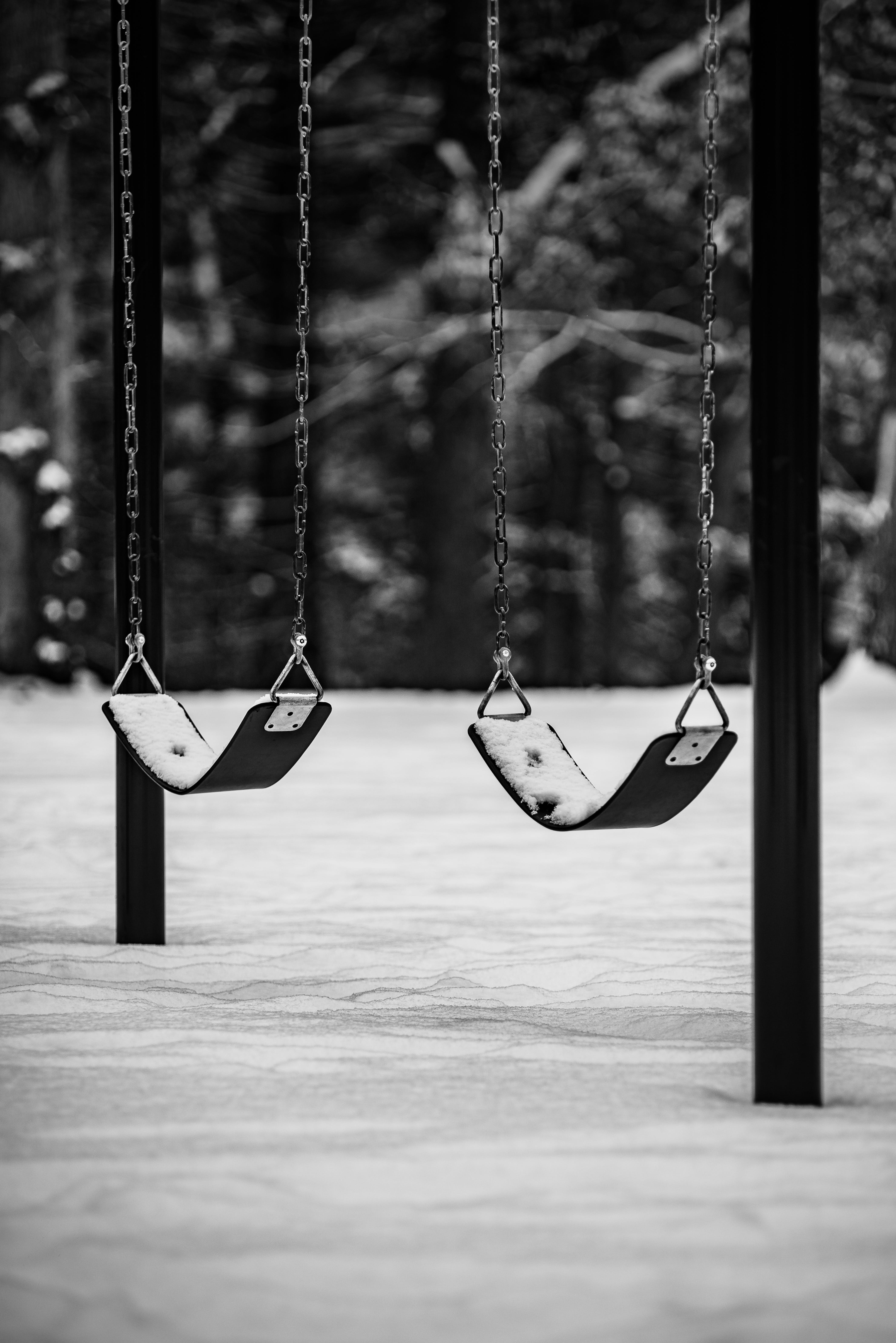 Grayscale Photo Of Outdoor Swings