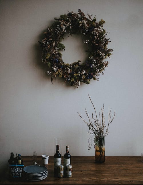 Green Wreath Hanging On White Wall