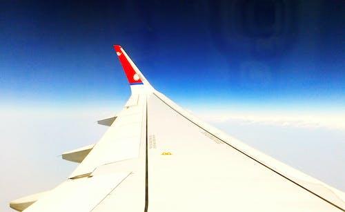 Kostenloses Stock Foto zu flügel, himmel, nepal fluggesellschaften