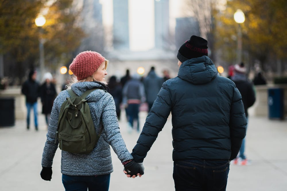Young couple at a park.   Photo: Pexels