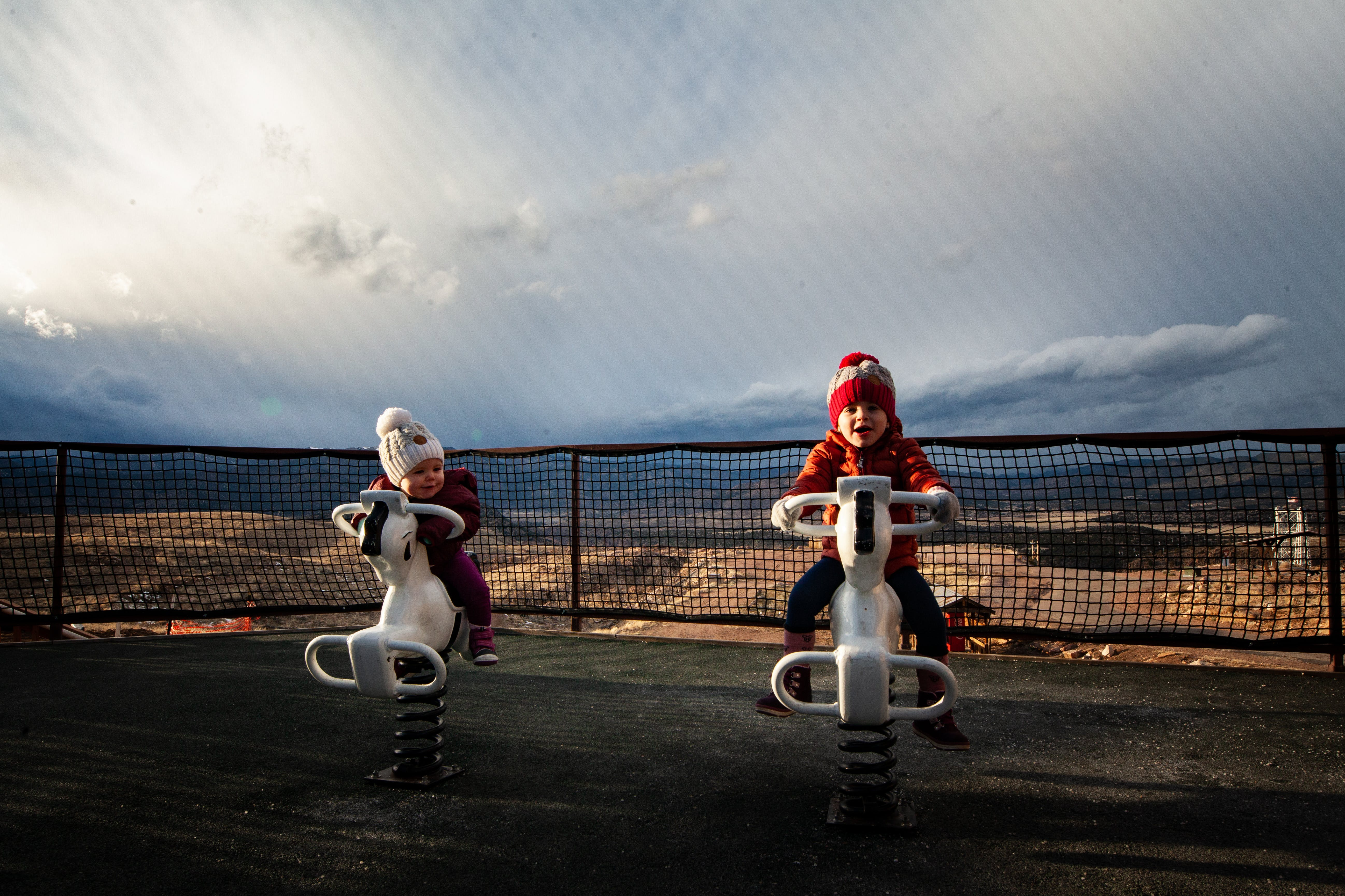 Photo of Toddlers Riding on Spring Horses