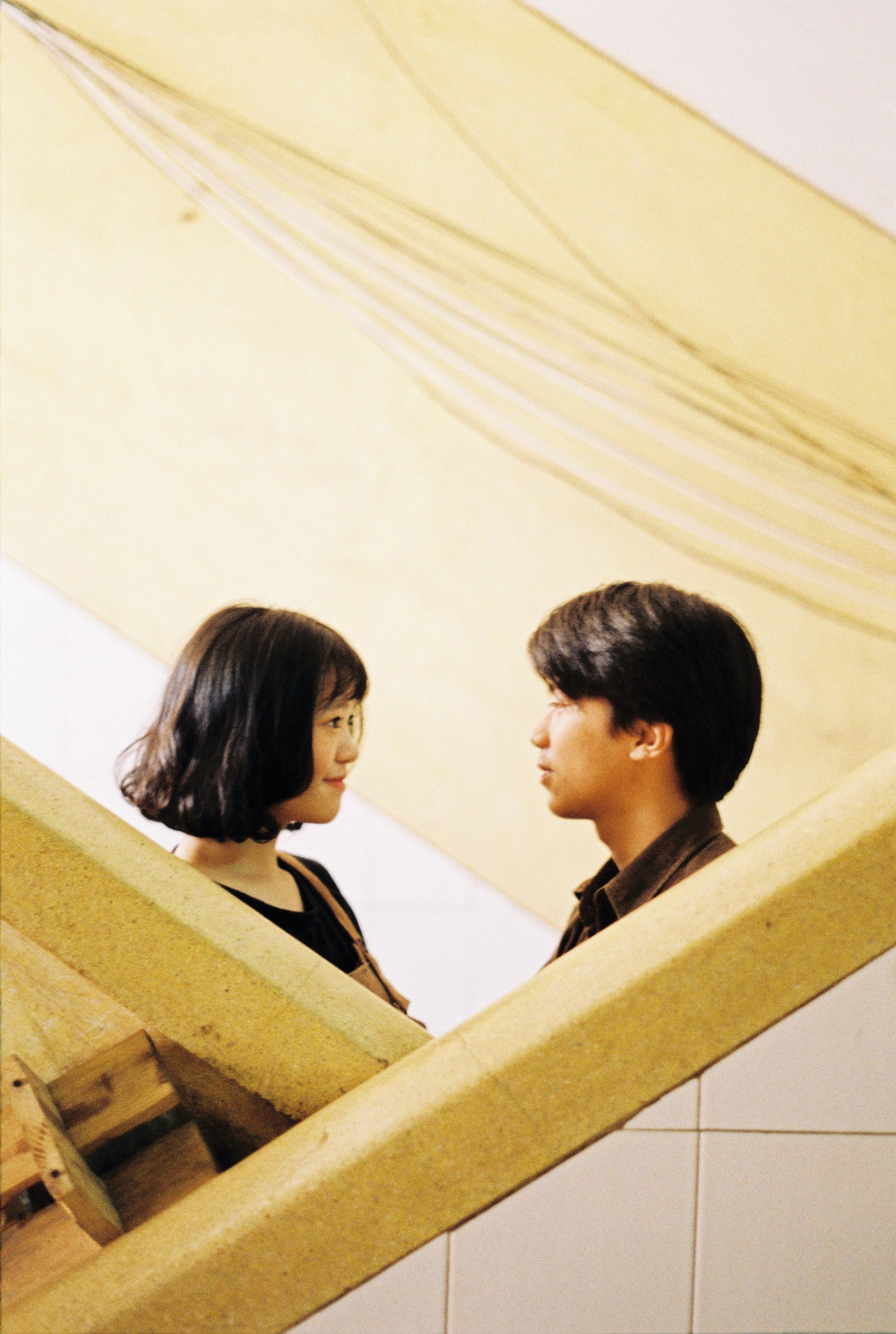 Woman And Man Facing Each Other Inside Room