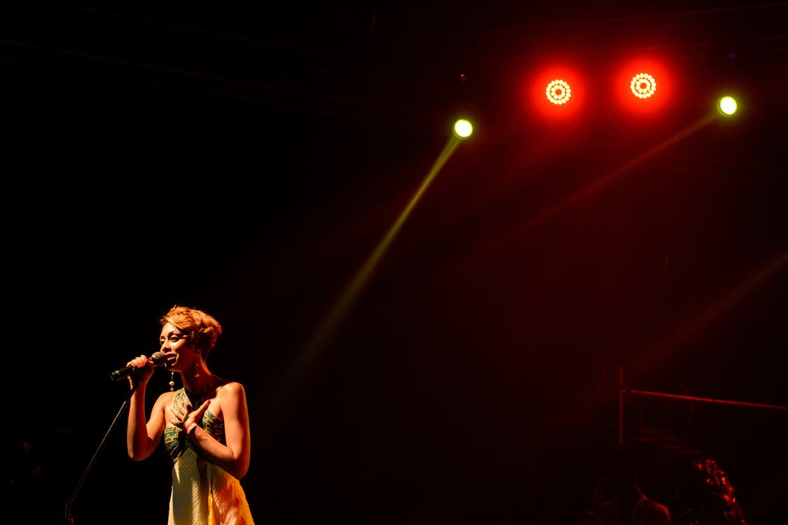 Photo of Woman Performing on Stage