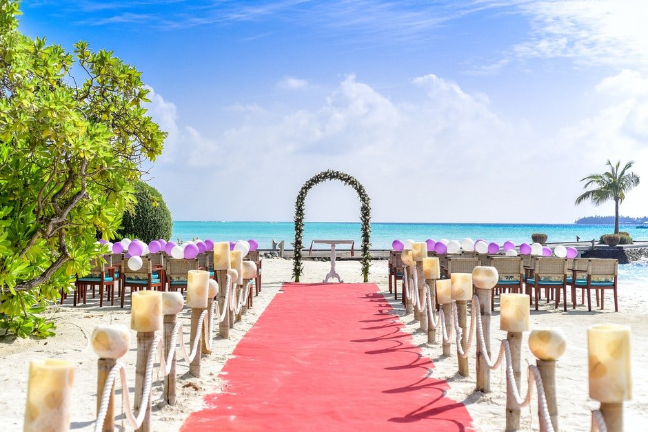 Beach Wedding Event Under White Clouds and Clear Sky during Daytime