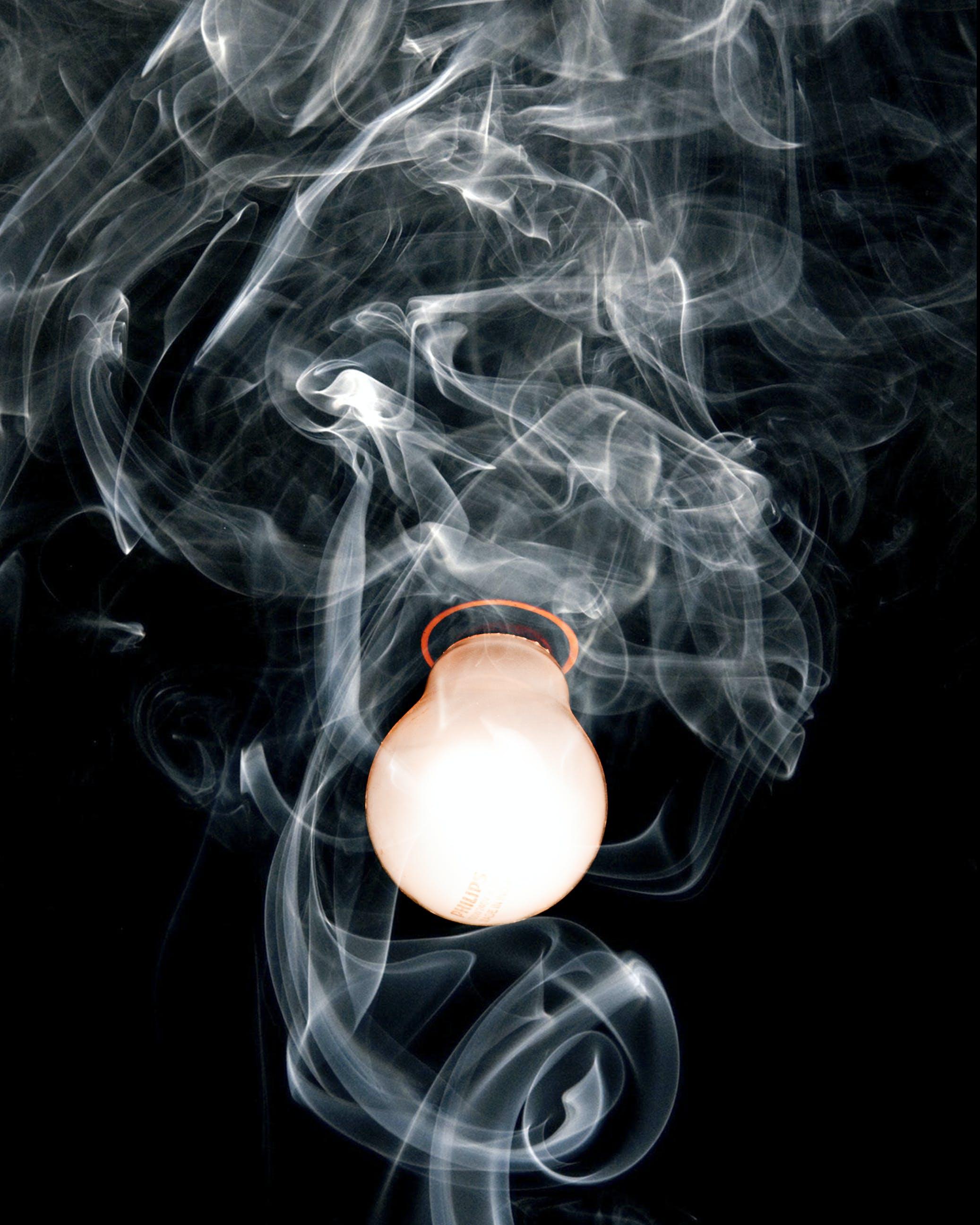 Close-Up Photo of Light Bulb With Smoke