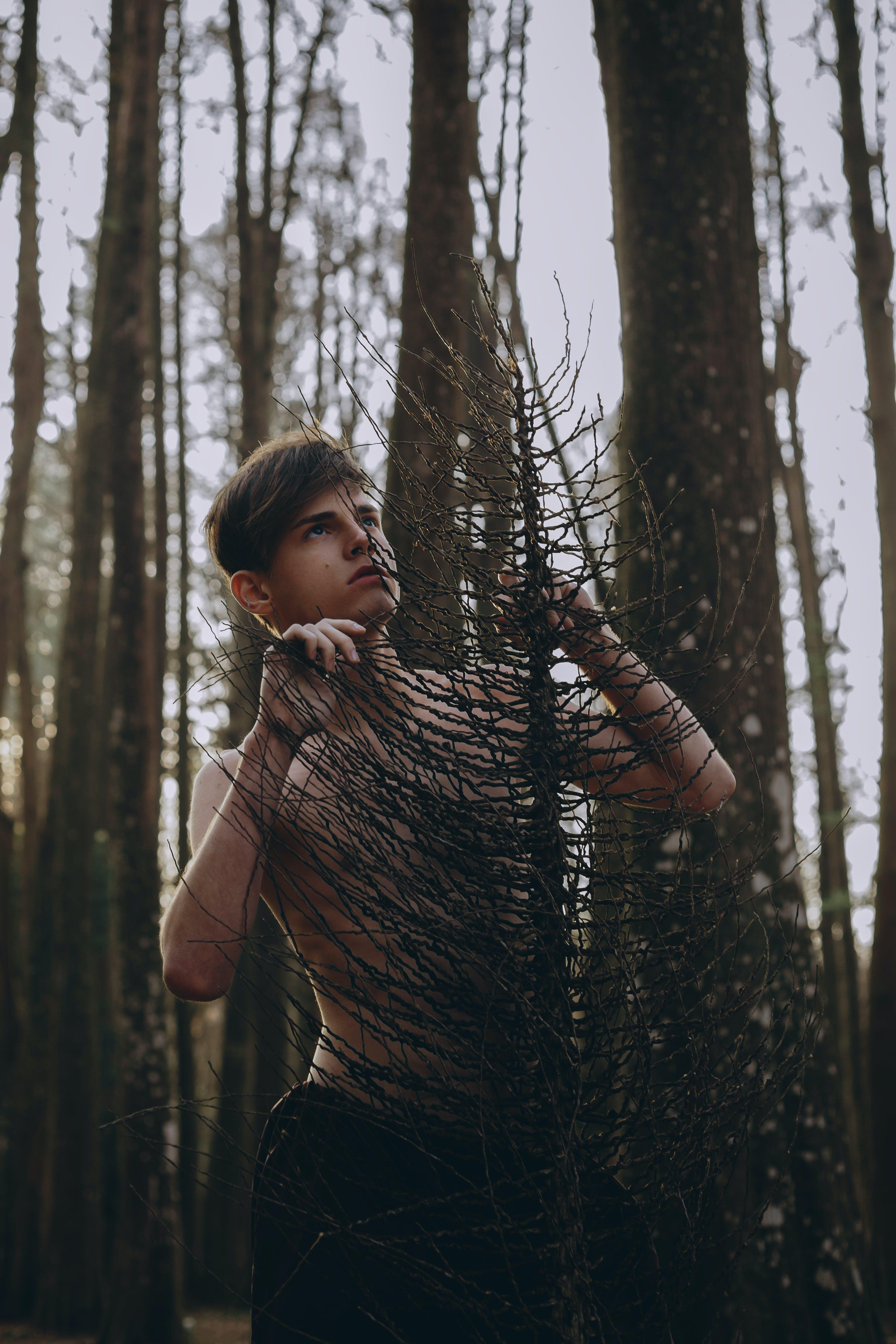 Man Holding Onto Tree
