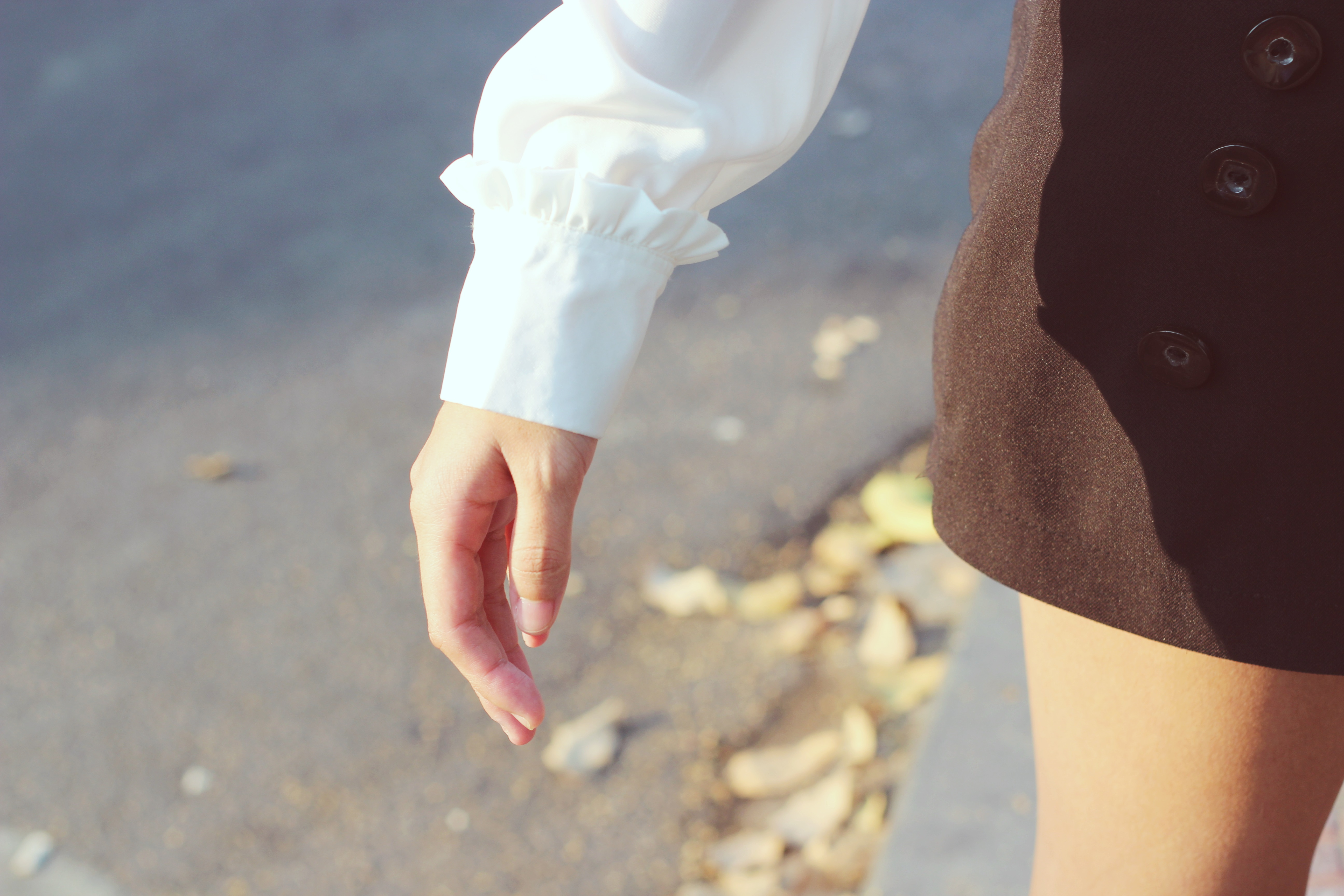 Person Wearing White Long-sleeved Shirt