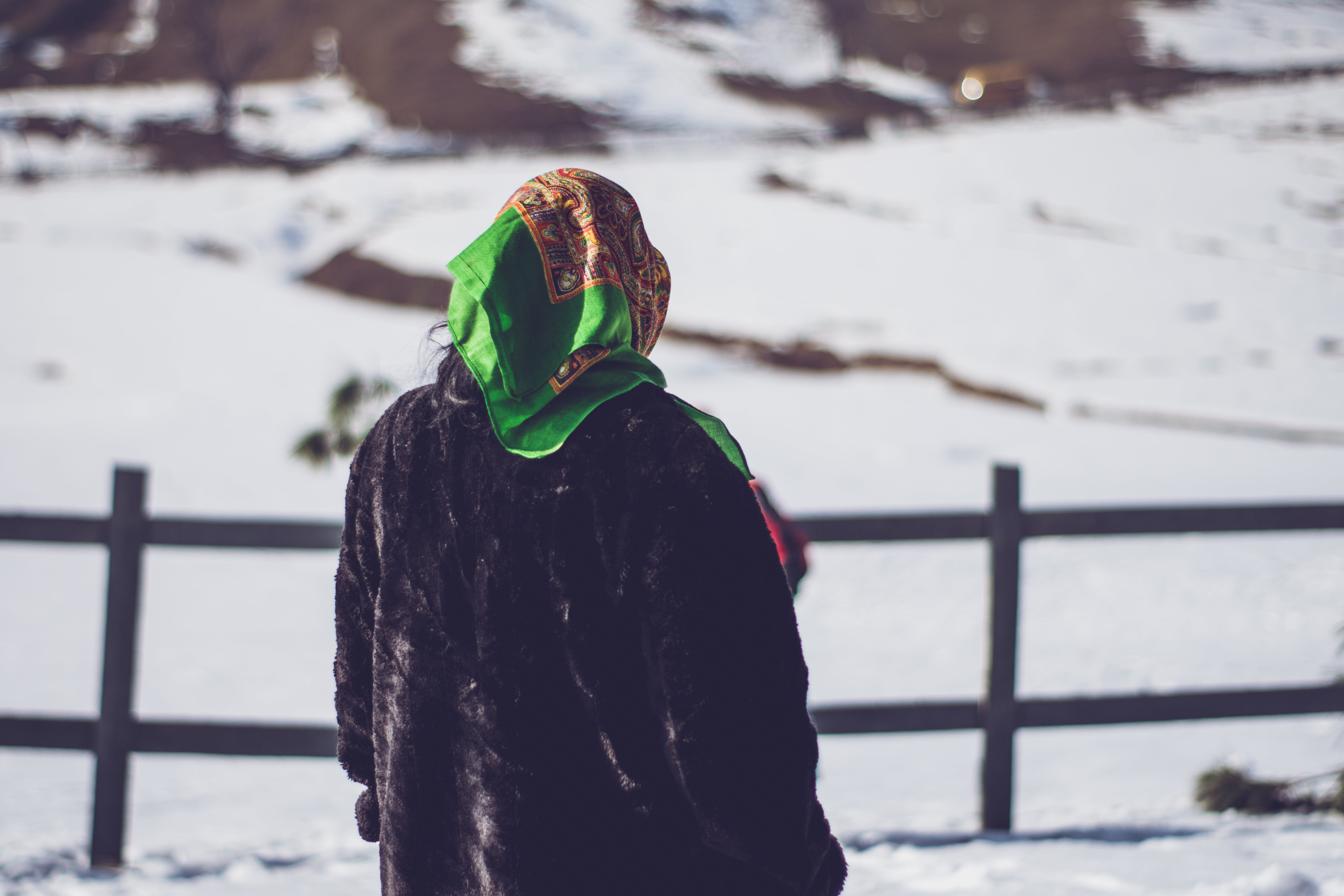 Selective Focus Photography of Person Standing on Snowfield