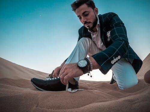 Man Tying His Shoelace